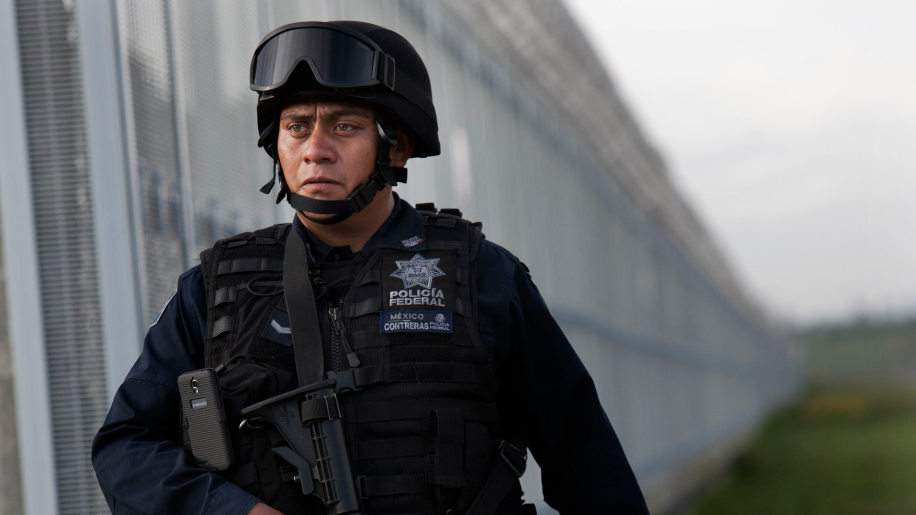 Federal police patrol near the Altiplano maximum security prison in Almoloya, Toluca, Mexico, early Sunday, July 12, 2015.