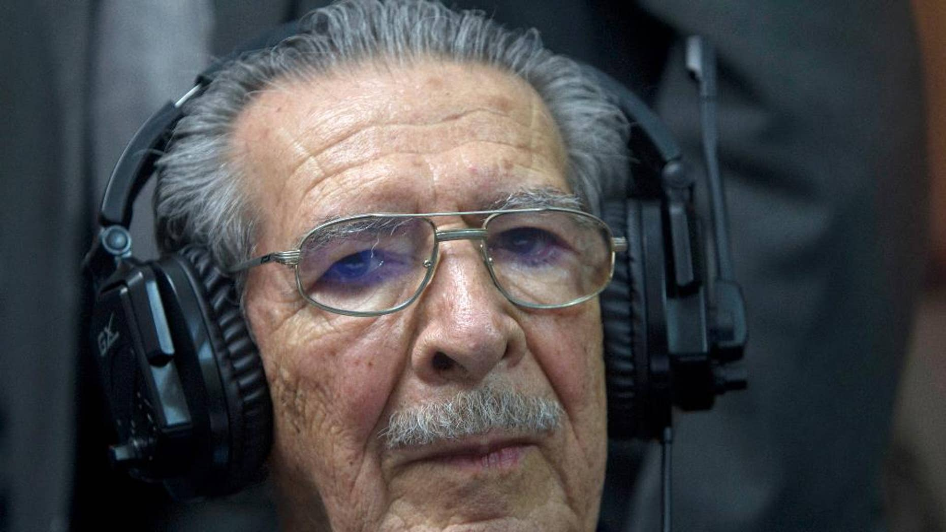 FILE - In this May 10, 2013 file photo, Guatemala's former dictator Jose Efrain Rios Montt wears headphones as he listens to the verdict in his genocide trial in Guatemala City. In an expert opinion dated July 1, 2015 and sent to the judge overseeing the first stage of Rios Montt's case, the 89-year-old was determined by Guatemala's National Institute of Forensic Sciences to be incapable of understanding the charges against him and of participating in his own defense. Prosecutors say Rios Montt is responsible for the deaths of almost 2,000 Mayan Indians, killed by the army between 1982 and 1983. (AP Photo/Moises Castilo, File)