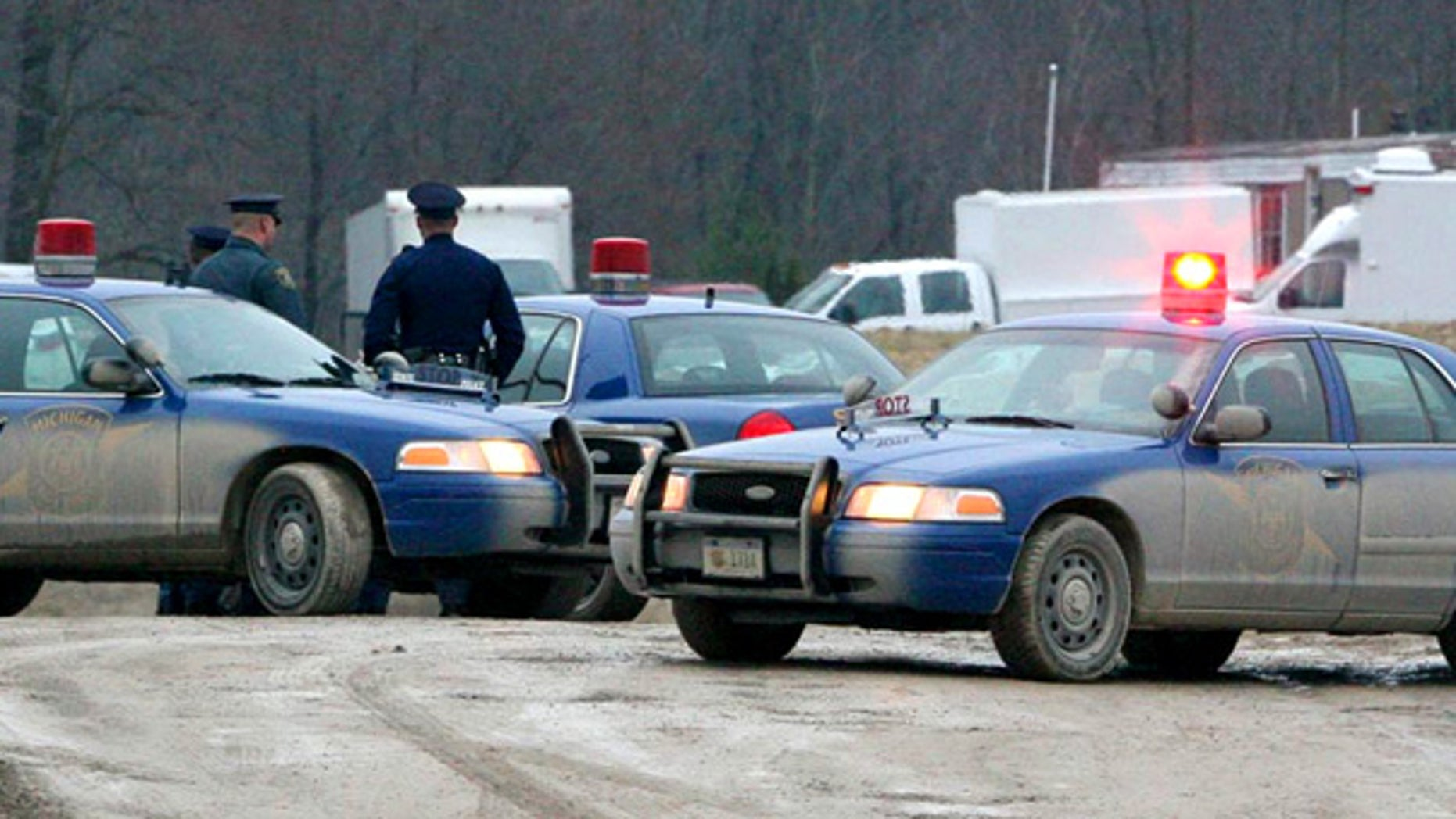 Mar. 28: Michigan State Police guard a home in Clayton after the FBI raided the home of a suspected militia leader.