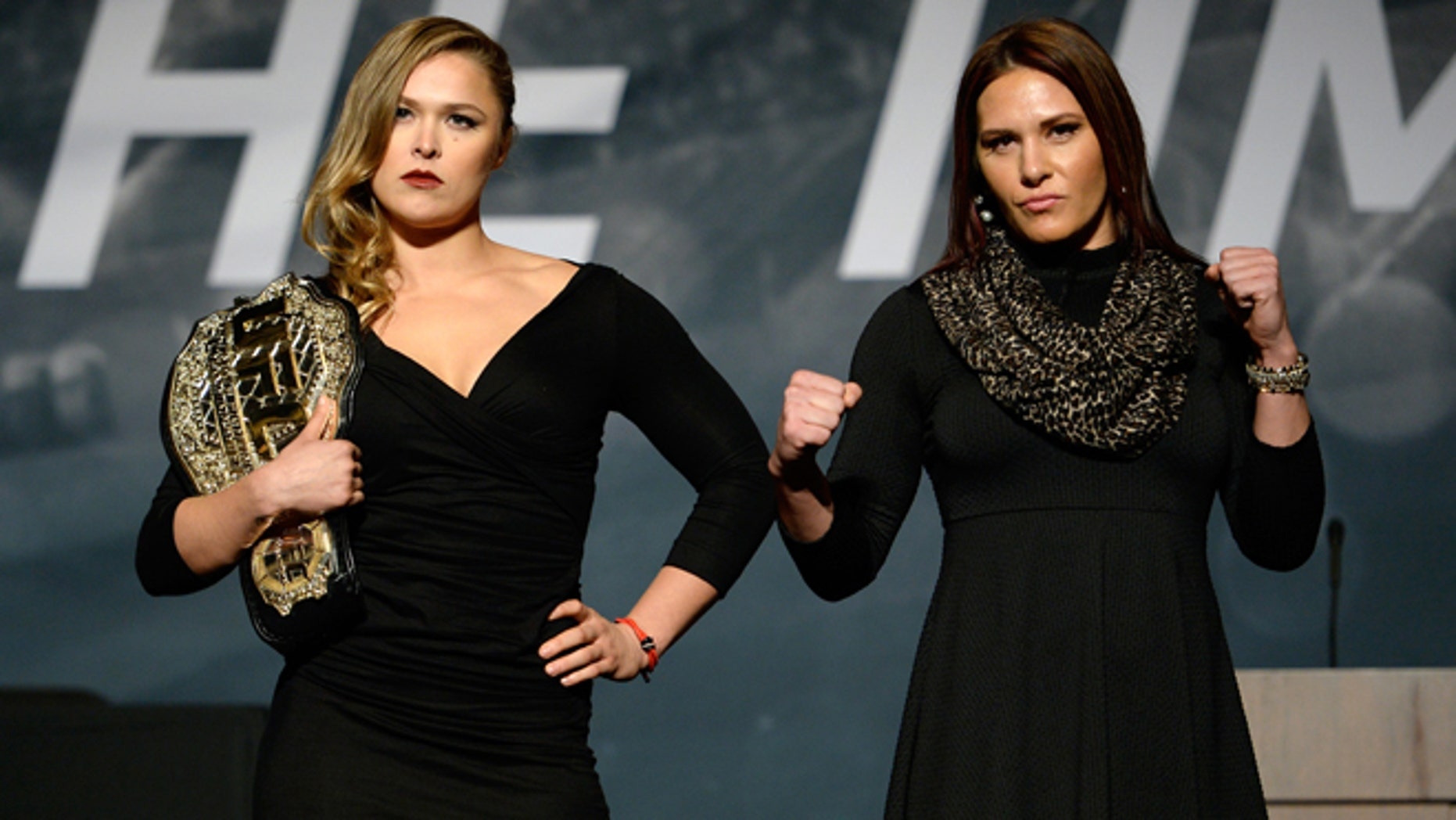 LAS VEGAS, NEVADA - NOVEMBER 17:  UFC women's bantamweight champion Ronda Rousey (L) and challenger Cat Zingano pose for the media during the UFC Time Is Now press conference at The Smith Center for the Performing Arts on November 17, 2014 in Las Vegas, Nevada. (Photo by Jeff Bottari/Zuffa LLC/Zuffa LLC via Getty Images)