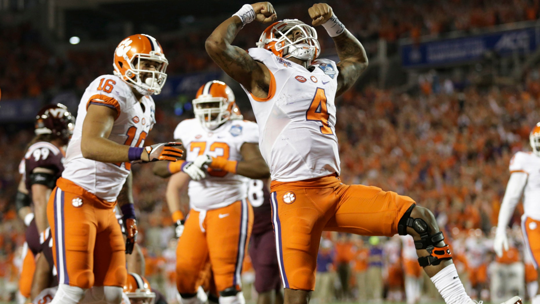 Clemson quarterback Deshaun Watson (4) celebrates his touchdown, during the second half of the Atlantic Coast Conference championship NCAA college football game against Virginia Tech, Saturday, Dec. 3, 2016, in Orlando, Fla. (AP Photo/Willie J. Allen Jr.)