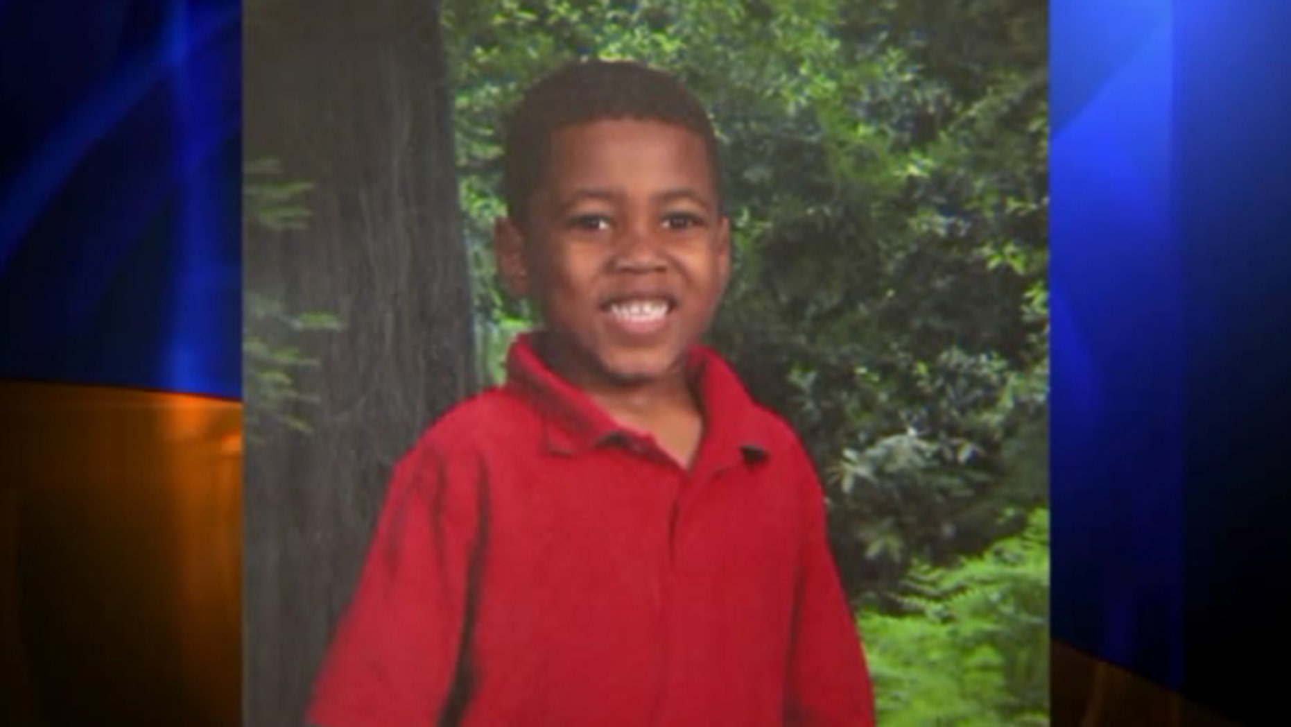 Aaris Conway's mother says the 7-year-old was climbing a tree and got caught up in his karate belt when he tried to jump down.