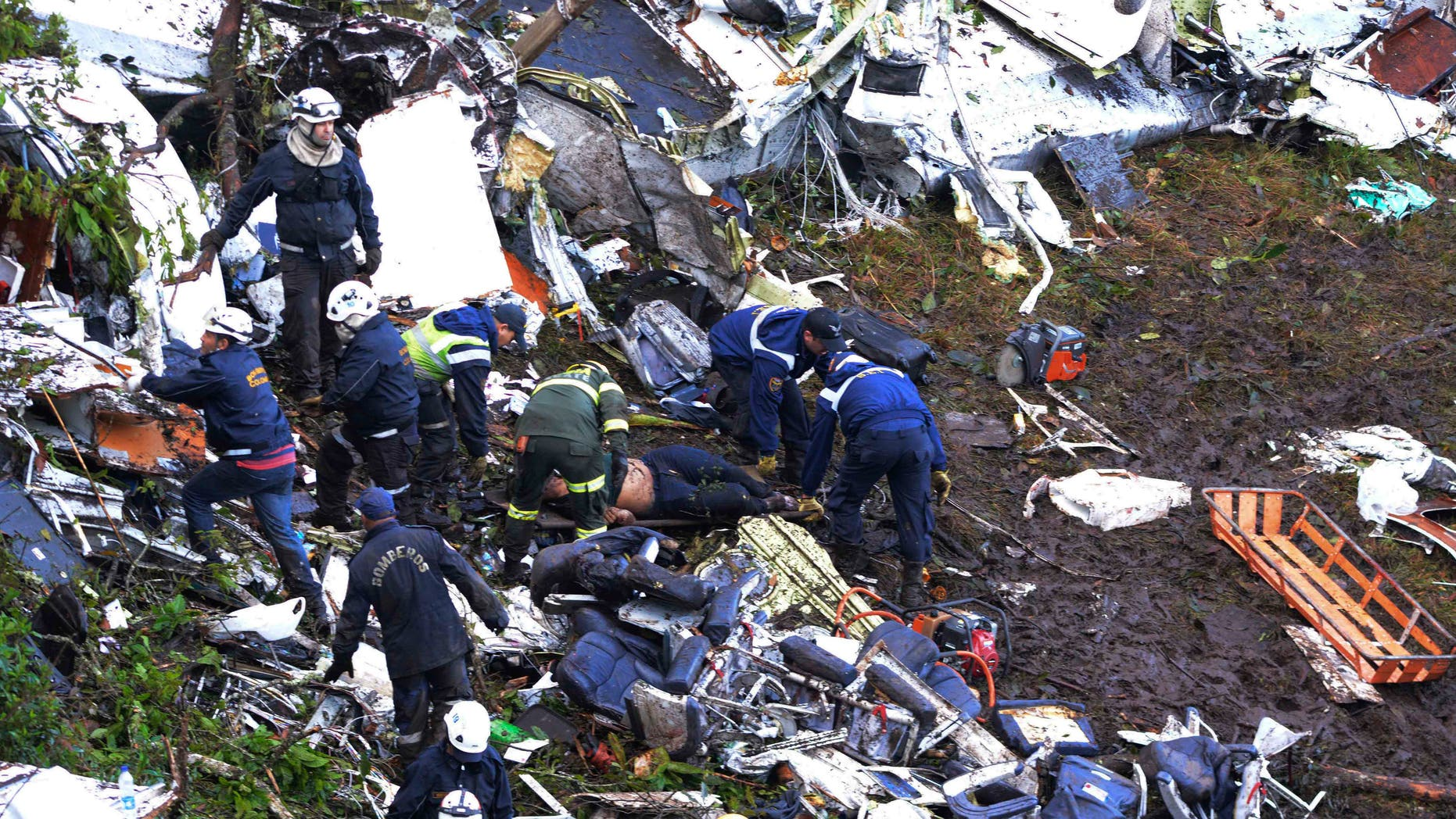 Rescue workers search for survivors outside Medellin, Colombia, Tuesday, Nov. 29, 2016.