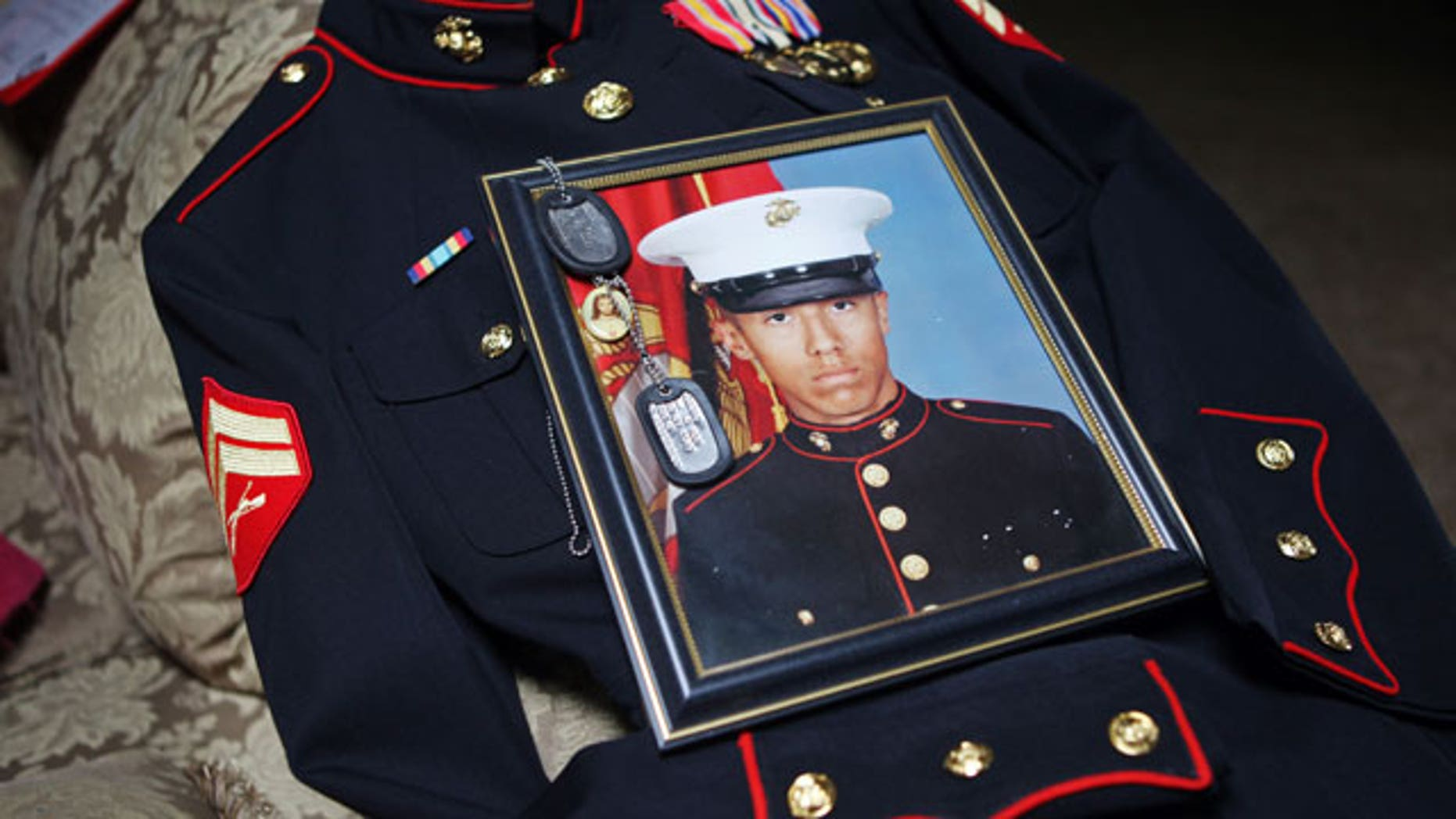 Jan. 15, 2012: Itzcoatl Ocampo's dress uniform, government military photo, dog tags and a religious medallion that went to war with him lie on display at Ocampo's home in Yorba Linda, Calif.