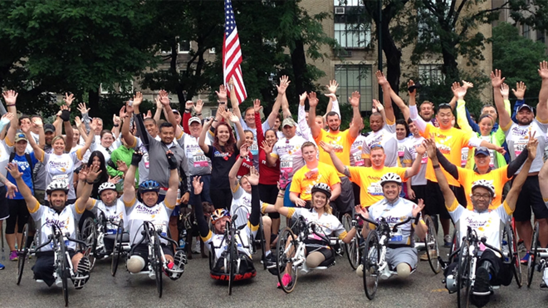 Shown here are veterans working with Achilles International, which trains disabled vets to compete in marathons. (Courtesy of Achilles International)