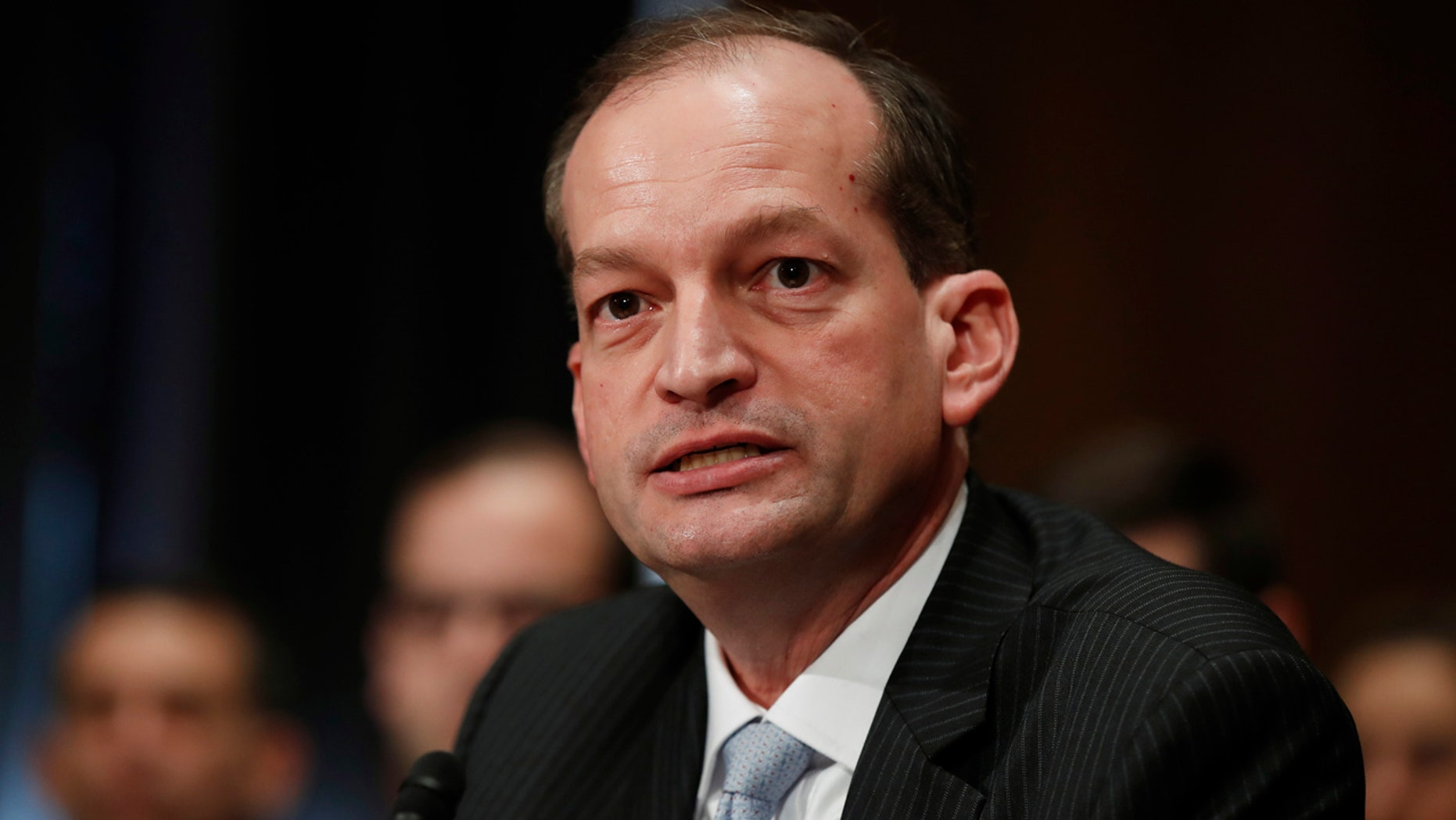 In this March 22, 2017, file photo, the labor secretary-designate, Alexander Acosta, testifies on Capitol Hill.