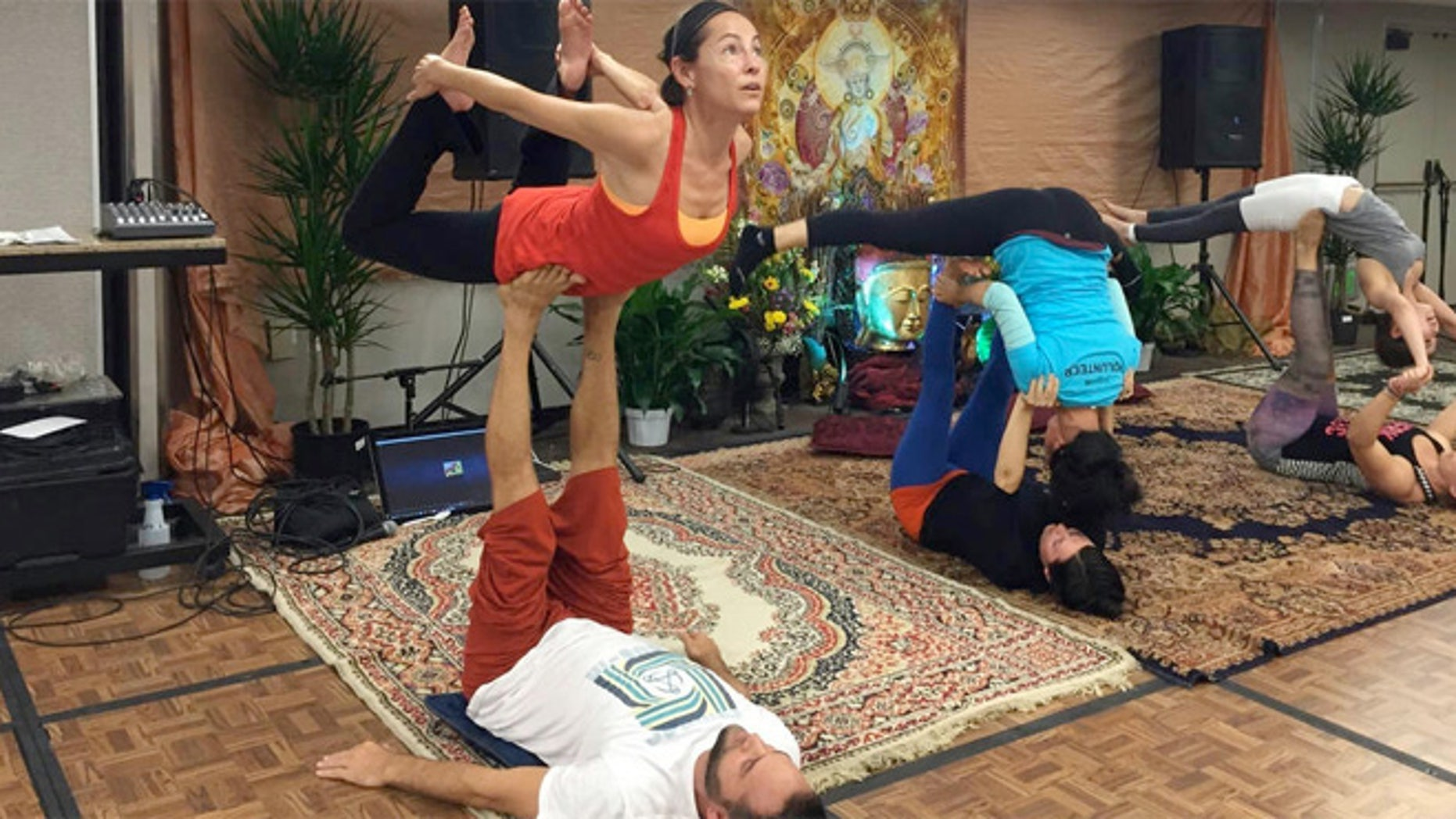 Trust is a key component in AcroYoga, as with this bow pose which had me high off the ground.