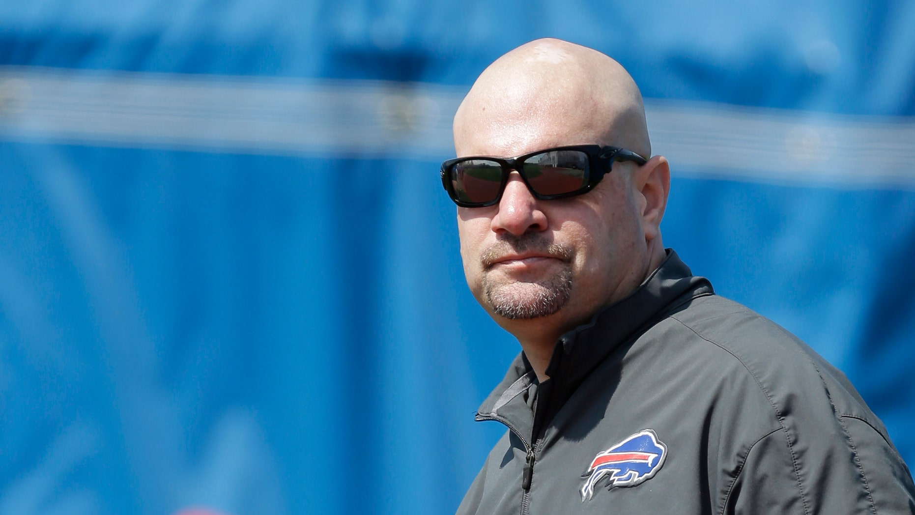 FILE - In this May 20, 2013 file photo,  Buffalo Bills new defensive coordinator Mike Pettine looks on during an optional NFL football workout in Orchard Park, N.Y. When it comes to putting together his defense, Pettine's intention is to keep opponents guessing. (AP Photo/David Duprey, File)