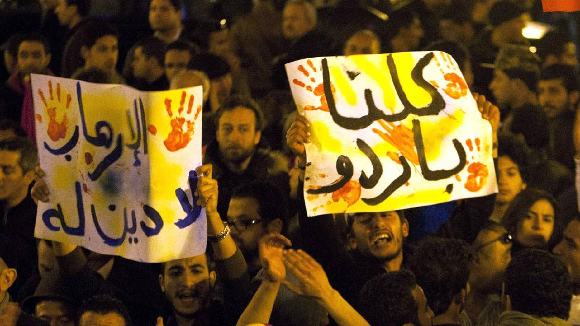 """Tunisians gather at Habib Bourguiba avenue to show solidarity with the victims of the attack at a museum in Tunis, Wednesday, March 18, 2015. Gunmen opened fire Wednesday at a major museum in Tunis, killing scores of people, mostly foreigners, in one of the worst attacks in this struggling North African democracy that depends heavily on tourism. Placard reads, """"no to terrorists"""". (AP Photo/Adel Mhamdi)"""