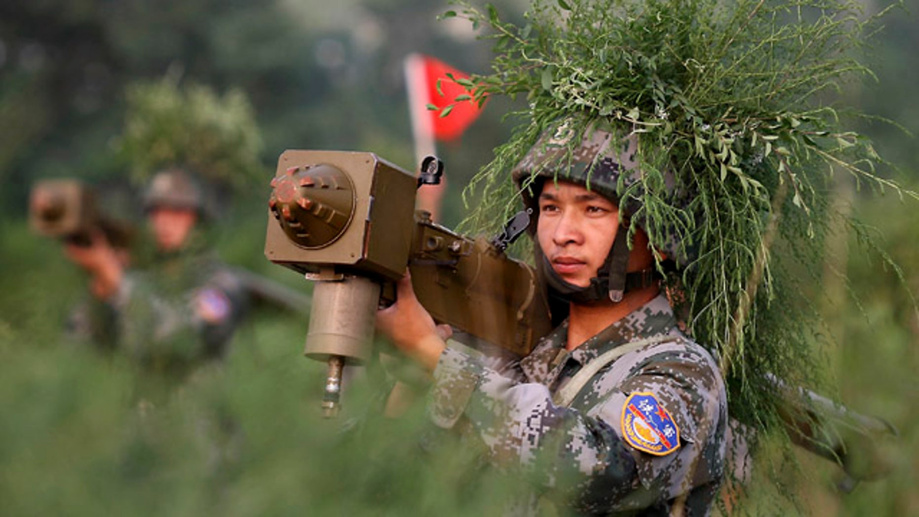 Aug. 4: Chinese soldiers take part in the Vanguard 2010 live-fire air defense exercise in central China's Henan Province.