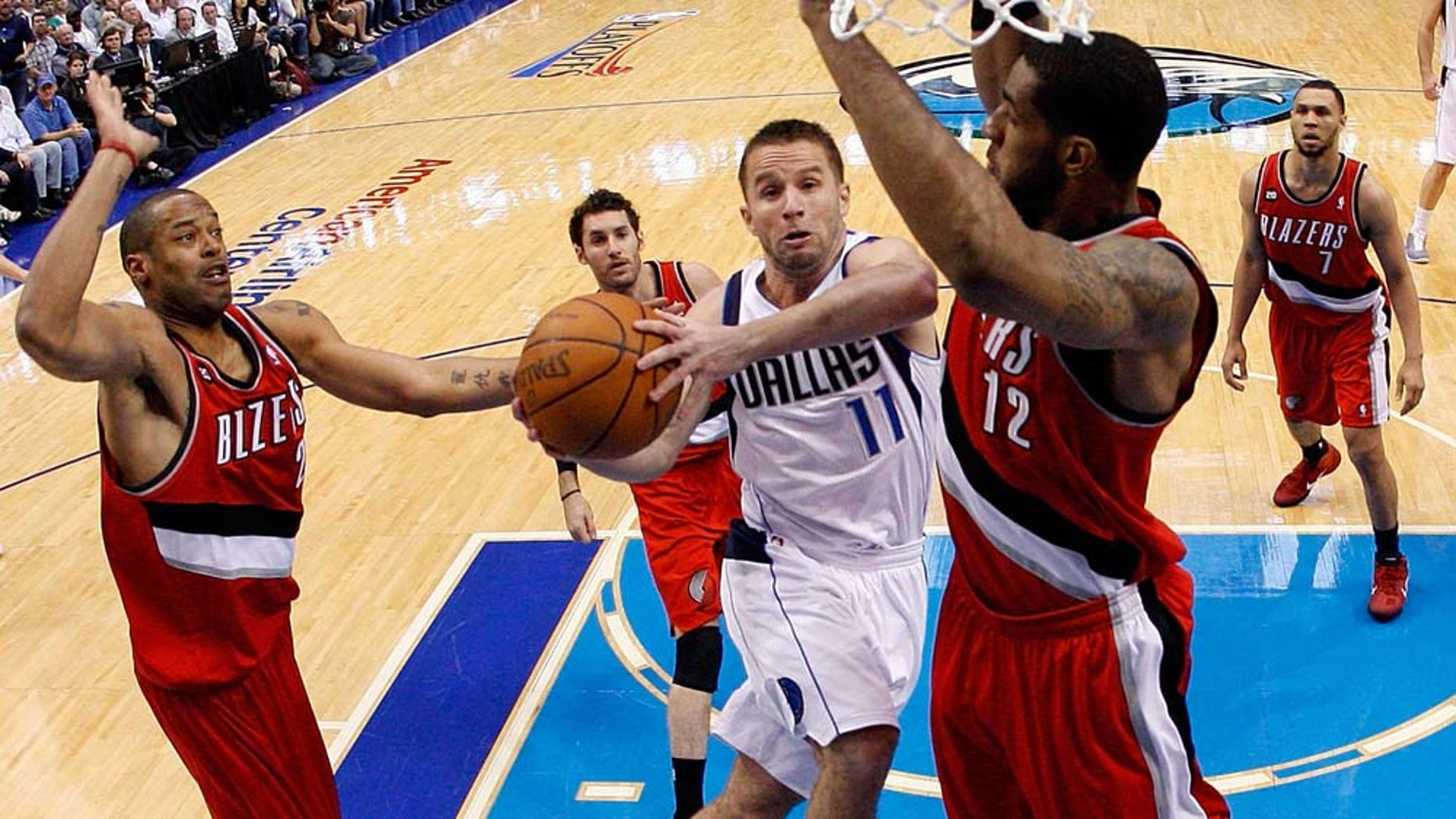 DALLAS, TX - APRIL 19:  Guard Jose Juan Barea #11 of the Dallas Mavericks takes a shot against LaMarcus Aldridge #12 of the Portland Trail Blazers in Game Two of the Western Conference Quarterfinals during the 2011 NBA Playoffs on April 19, 2011 at American Airlines Center in Dallas, Texas.  NOTE TO USER: User expressly acknowledges and agrees that, by downloading and or using this photograph, User is consenting to the terms and conditions of the Getty Images License Agreement.  (Photo by Ronald Martinez/Getty Images)
