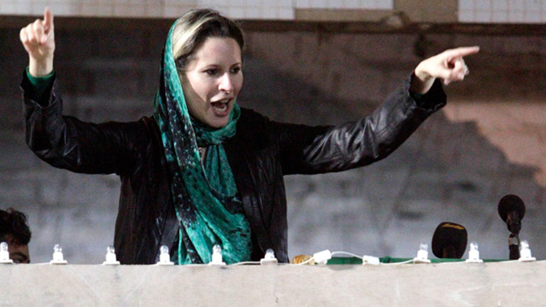 April 15: Aisha Qaddafi, daughter of Libyan leader Muammar al-Qaddafi, encourages Libyan people gathering at the Bab Al Azizia compound in Tripoli, Libya.