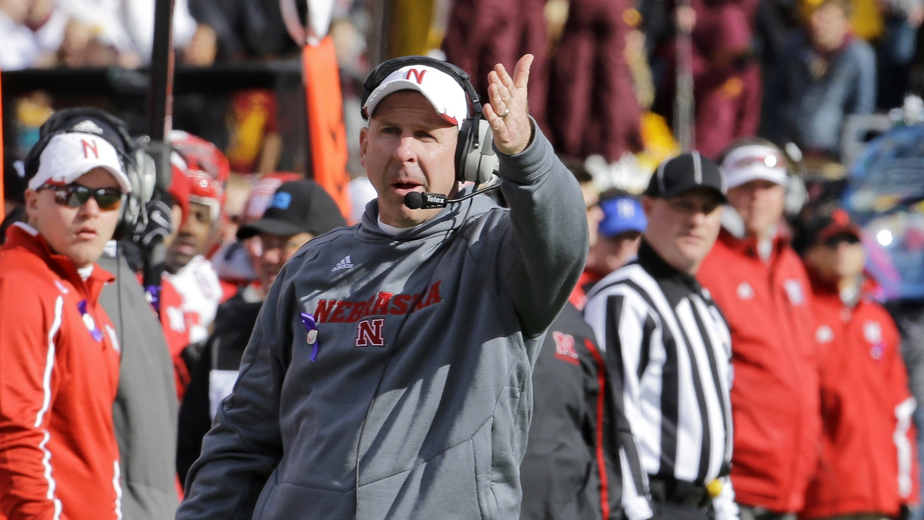 Nebraska head coach Bo Pelini disagrees with a call during the fourth quarter of an NCAA college football game against Minnesota in Minneapolis Saturday, Oct. 26, 2013. Minnesota beat Nebraska 34-23. (AP Photo/Ann Heisenfelt)