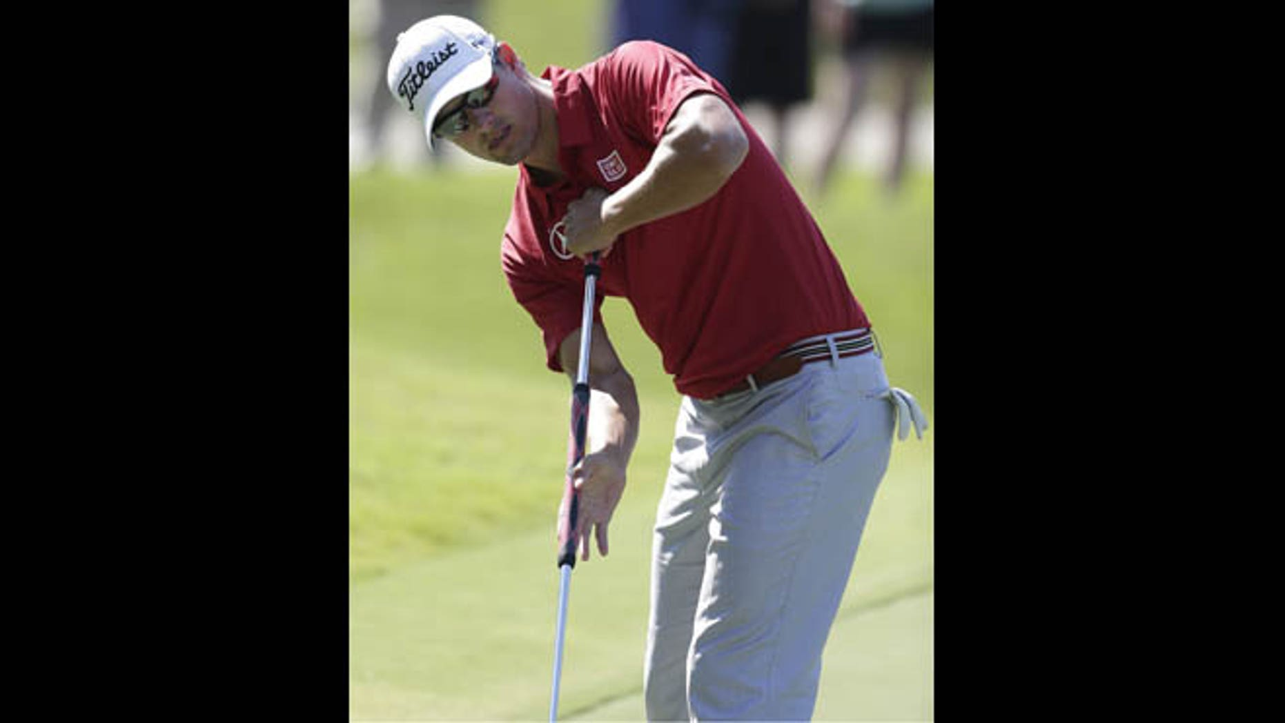 May 9, 2013: Adam Scott of Australia is seen putting on the 15th green during the first round of The Players championship golf tournament at TPC Sawgrass in Ponte Vedra Beach, Fla. Golf's governing bodies have adopted a new rule that outlaws the putting stroke used by four of the last six major champions. The Royal & Ancient Golf Club and U.S. Golf Association announced Tuesday, May 21, 2013 that Rule 14-1b would start in 2016. The new rule will make it illegal to anchor the club against the body when making a golf stroke.