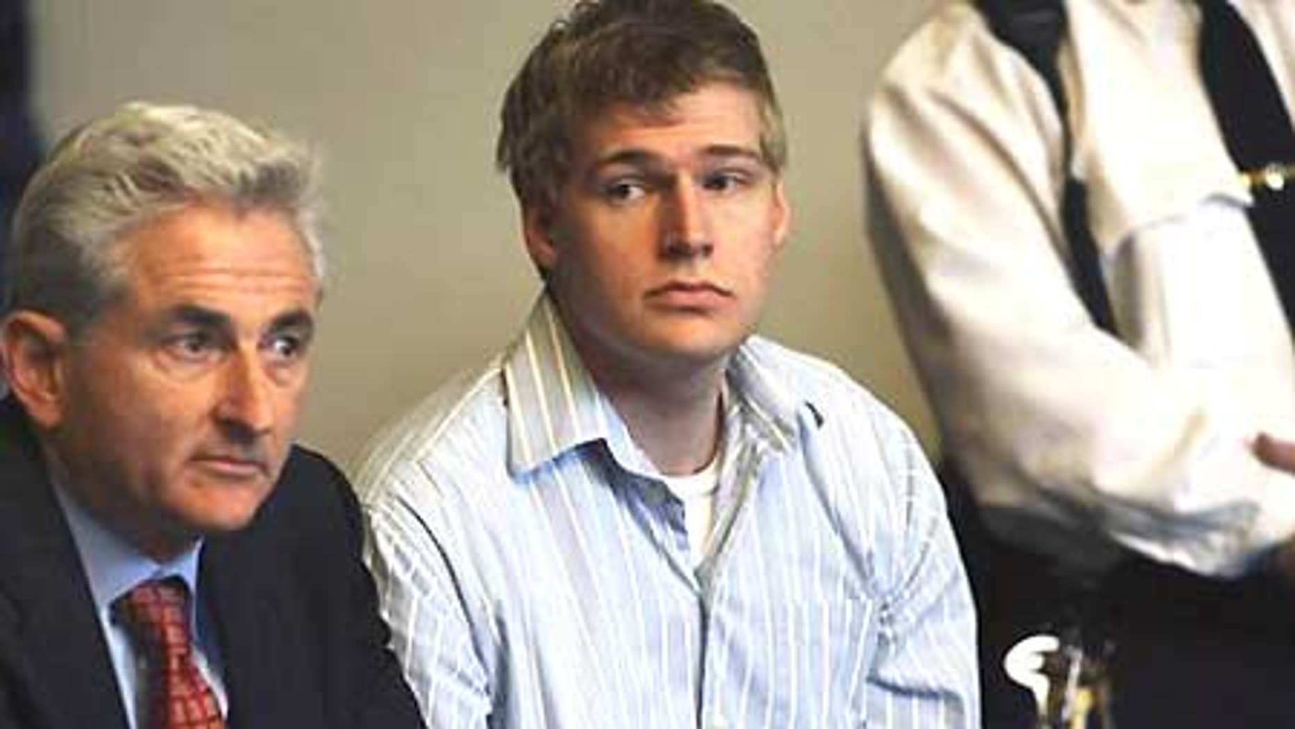 April 21: Boston University medical student Philip Markoff, center, sits with his lawyer John Salsberg during his arraignment in Boston.