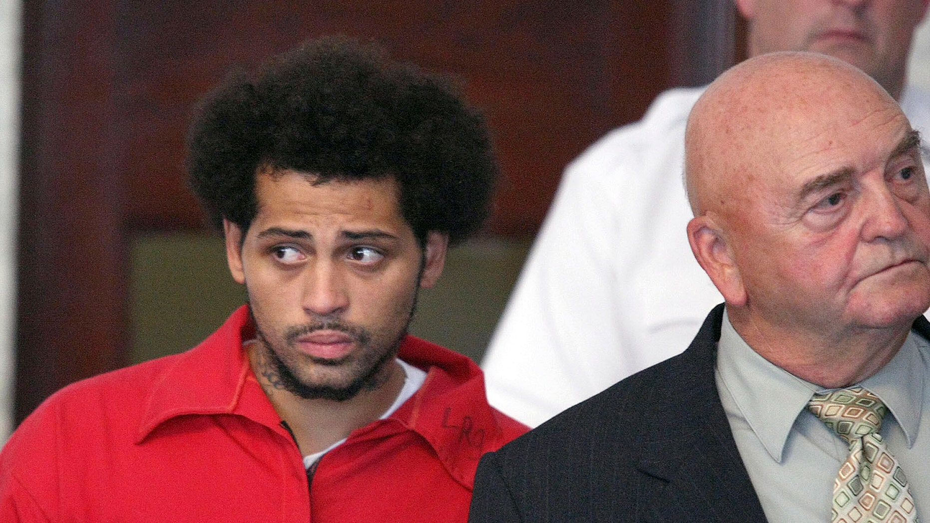 FILE - In this Friday, June 28, 2013 file photo, Carlos Ortiz, an associate of ex-New England Patriot Aaron Hernandez, left, enters the Attleboro District Court with attorney John Connors, right, for his arraignment on weapons charges, in Attleboro, Mass. Ortiz. who has been charged as an accessory to murder, is due in Fall River Superior Court Thursday afternoon, Jan. 9, 2014. (AP Photo/The Boston Globe, George Rizer, Pool, File)