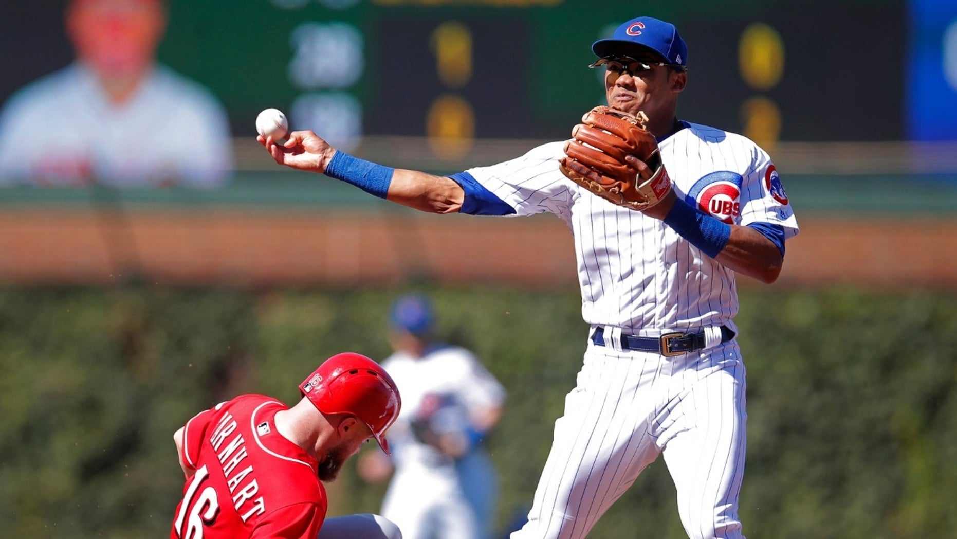 Chicago Cubs shortstop Addison Russell [right] was placed on administrative leave Friday following fresh allegations of domestic violence from his ex-wife.
