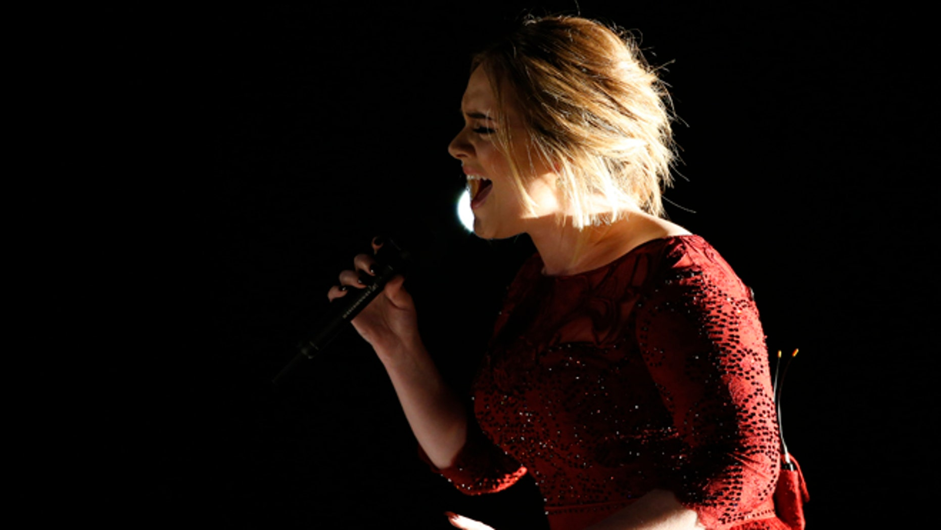 """February 15, 2016. Singer Adele performs """"All I Ask"""" on stage at the 58th Grammy Awards in Los Angeles, California."""