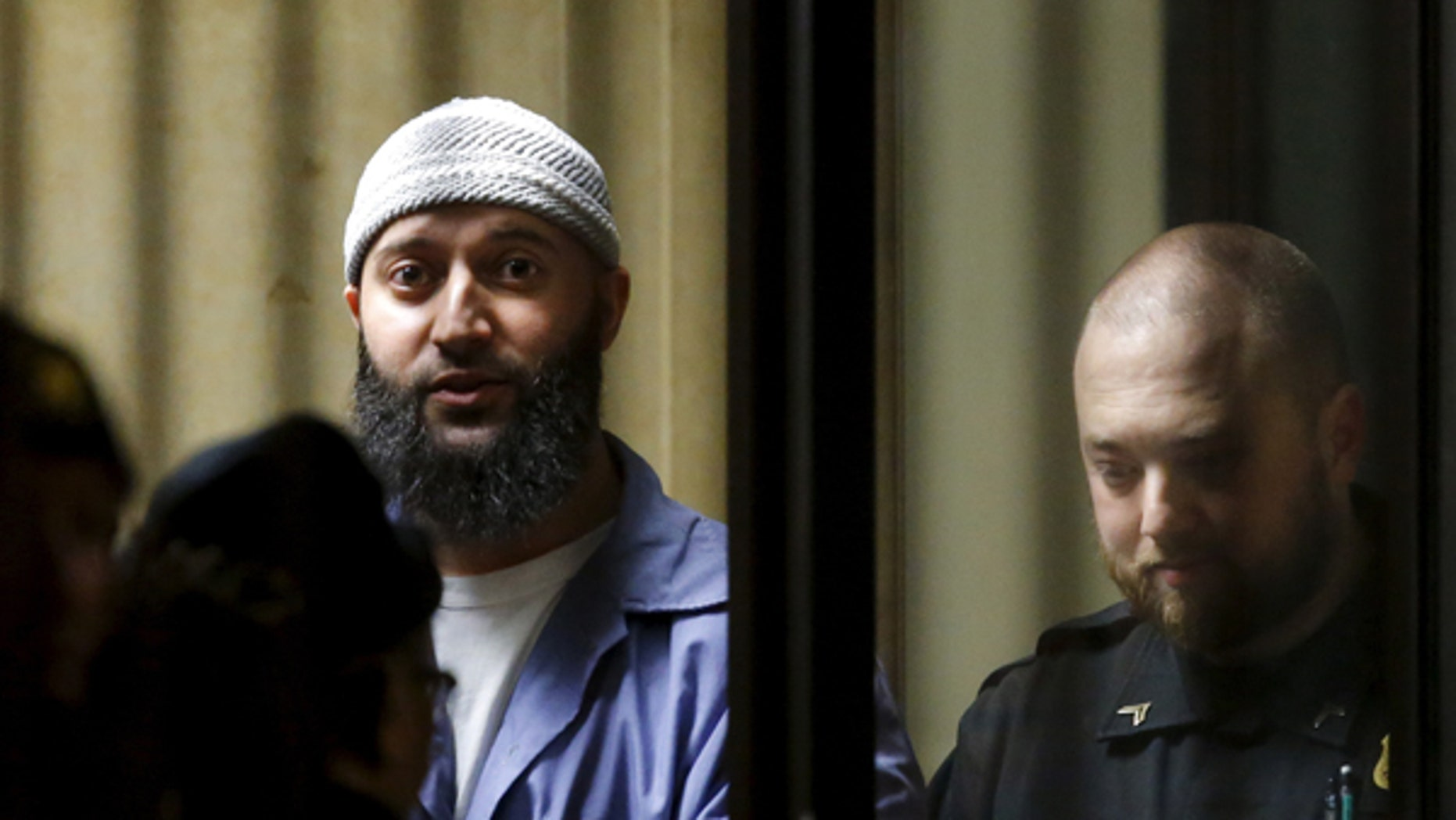 """Convicted murderer Adnan Syed leaves the Baltimore City Circuit Courthouse in Baltimore, Maryland February 5, 2016. The Maryland man whose 2000 murder conviction was thrown into question by the popular """"Serial"""" podcast was in court today to argue he deserved a new trial because his lawyers had done a poor job with his case."""