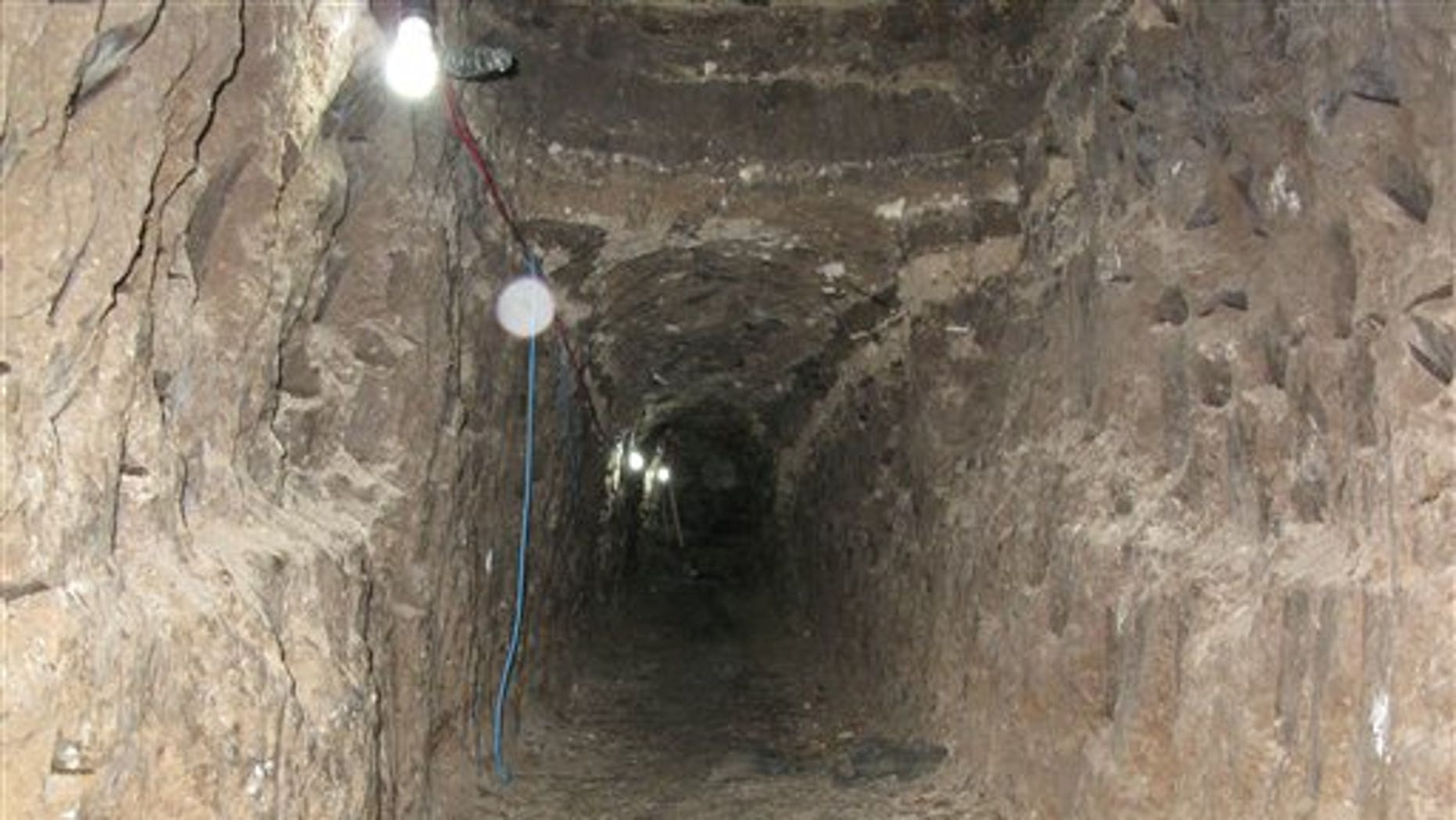 This photo released by U.S. Immigration and Customs Enforcement (ICE) on Friday, Nov. 26, 2010, shows a cross-border tunnel that authorities say was used as a major underground drug passage. The tunnel found Thursday is 2,200 feet long, more than seven football fields, and runs from the kitchen of a home in Tijuana, Mexico, to two warehouses in San Diego's Otay Mesa industrial district, said Mike Unzueta, head of investigations at U.S. Immigration and Customs Enforcement in San Diego. (AP Photo/U.S. Immigration and Customs Enforcement)