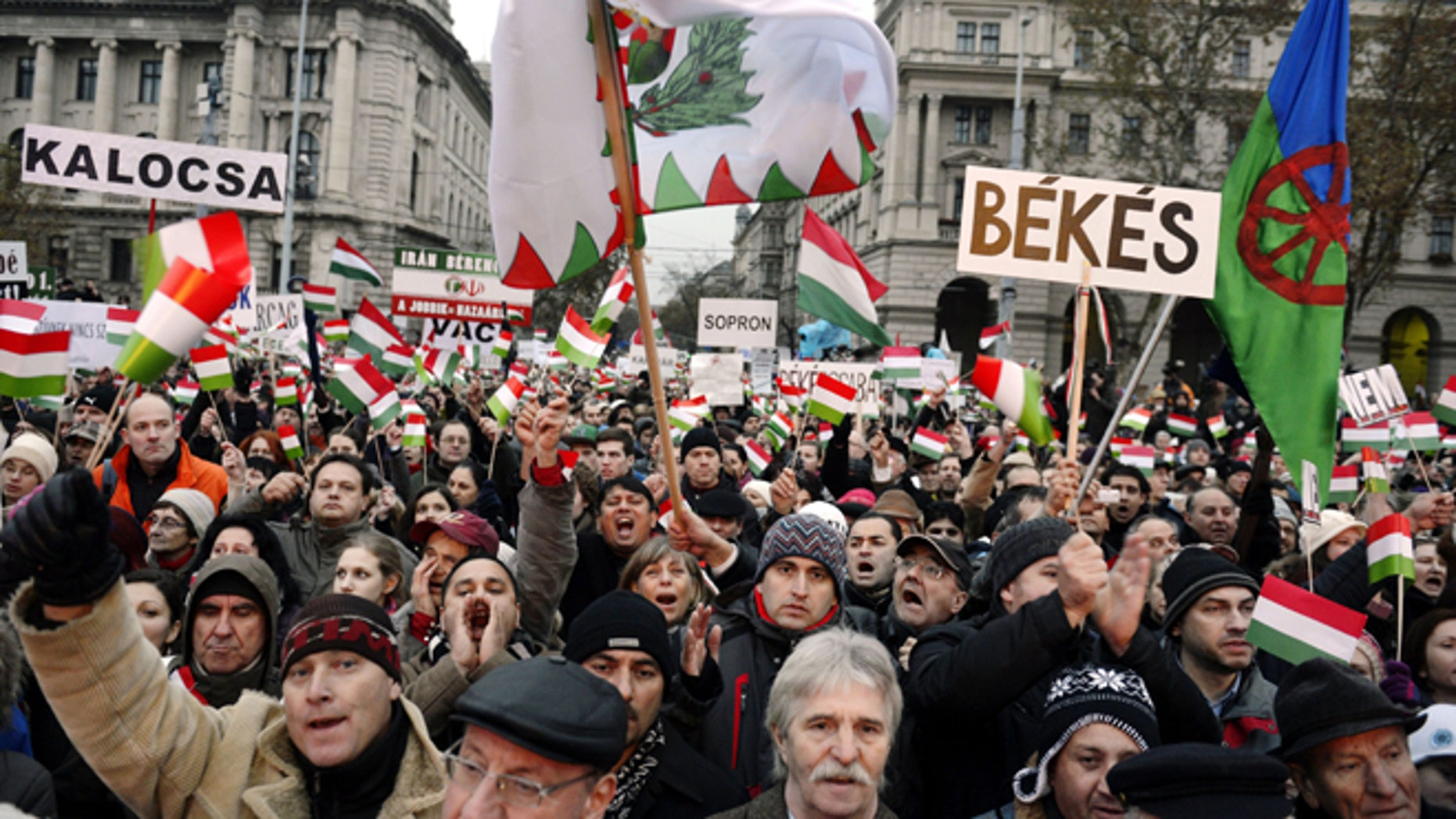 Dec. 2, 2012: Participants wave Hungarian national flags and a flag of Romas, right, as thousands of people attend a protest called Mass Demonstration Against Nazism in front of the Parliament building (unseen) in Budapest, Hungary.