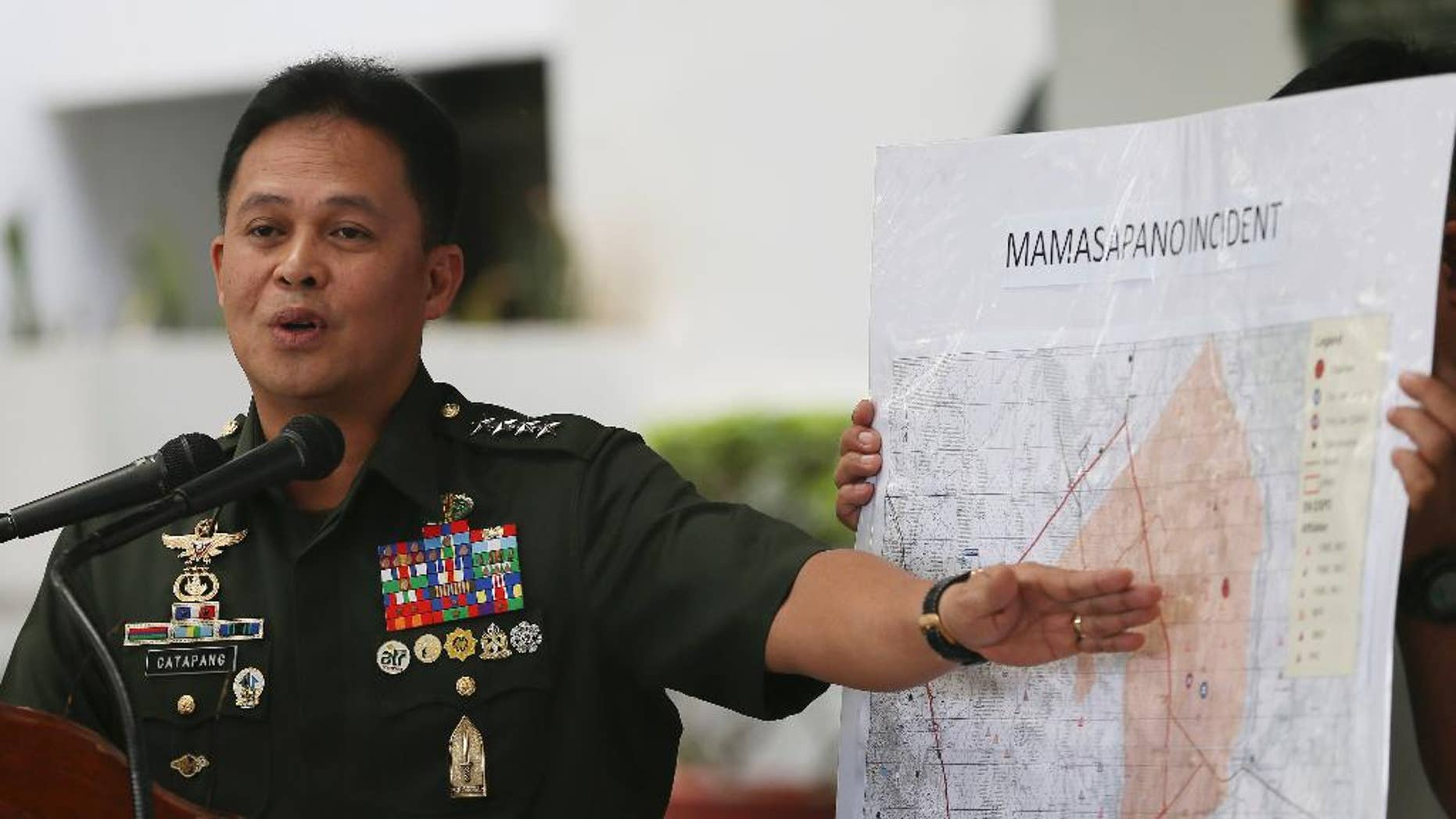 FILE - In this Feb. 4, 2015 file photo, Philippine Armed Forces Chief Gen. Gregorio Pio Catapang points to the map where the alleged clash between elite police commandos known as Special Action Forces (SAF) and Muslim rebels took place on Jan. 25 during a news conference at the Armed Forces of the Philippines headquarters at Camp Aguinaldo in suburban Quezon city, northeast of Manila, Philippines. A monthlong Philippine offensive against hard-line Muslim rebels ended Monday, March 30 after 139 insurgents were killed, 12 others were captured and bomb-making strongholds were seized by troops, the military chief said. (AP Photo/Bullit Marquez, File)