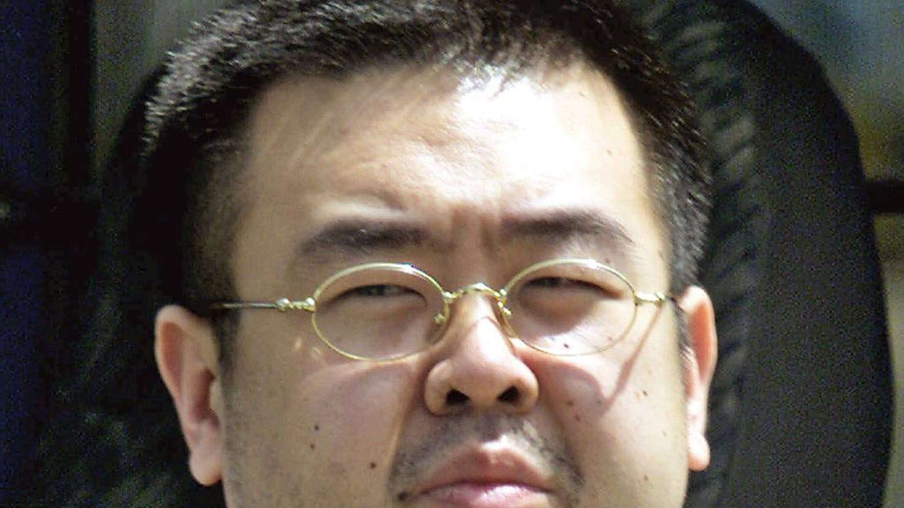FILE - This May 4, 2001, file photo shows Kim Jong Nam, exiled half brother of North Korea's leader Kim Jong Un, in Narita, Japan. Kim Jong Nam, 46, was targeted Monday, Feb. 13, 2017, in the Kuala Lumpur International Airport, Malaysia, and later died on the way to the hospital according to a Malaysian government official. Malaysia's Deputy Prime Minister Ahmad Zahid Hamidi says the identity of Kim Jong Nam, who was killed last month, was confirmed with the DNA sample from one of his children. (AP Photos/Shizuo Kambayashi, File)