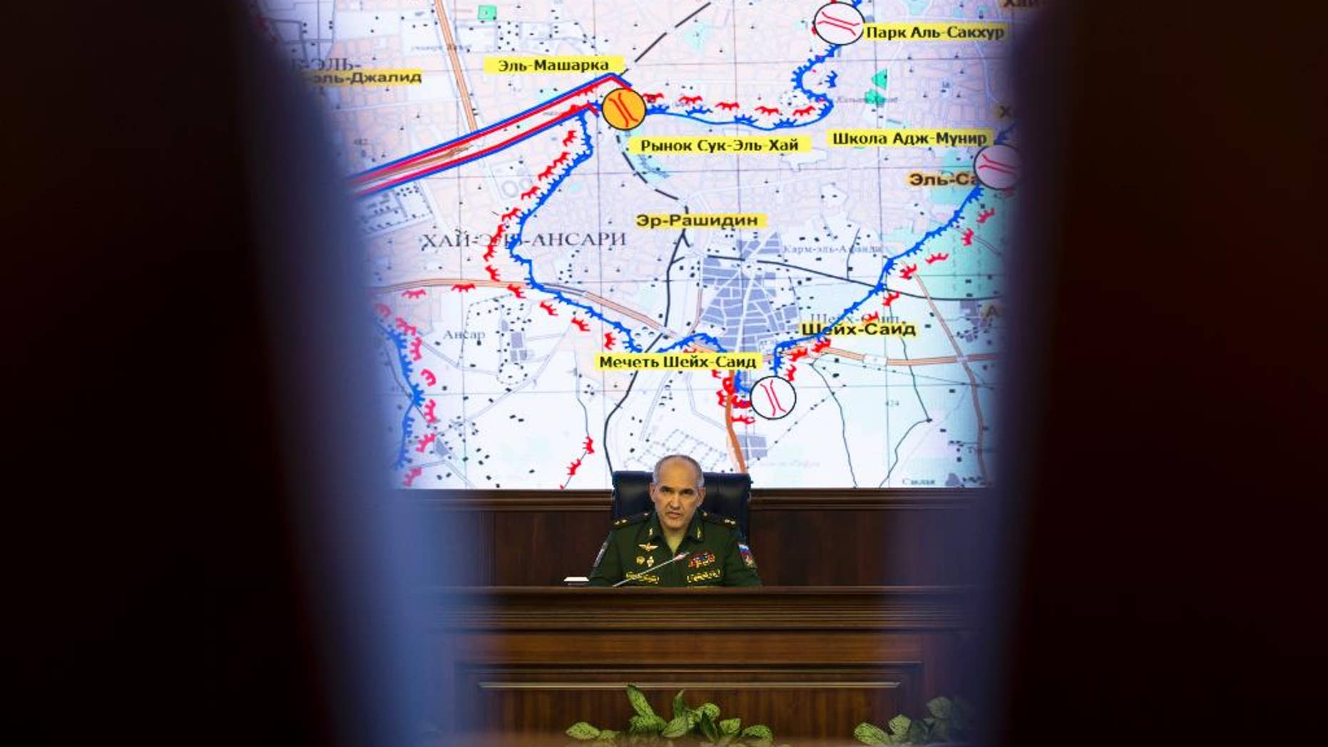 """Lt. Gen. Sergei Rudskoi of the Russian military's General Staff speaks in front of a map of the Aleppo area, at a briefing at the Russian Defense Ministry's headquarters in Moscow, Russia, Wednesday, Oct. 19, 2016. The Russian military says that Russian and Syrian warplanes are staying away from Aleppo a day before a temporary pause in the military push declared by Moscow. Lt. Gen. Sergei Rudskoi said the """"humanitarian pause"""" in Aleppo will last from 8 a.m. to 7 p.m. Thursday, three hours longer than the Russian military initially announced. (AP Photo/Alexander Zemlianichenko)"""
