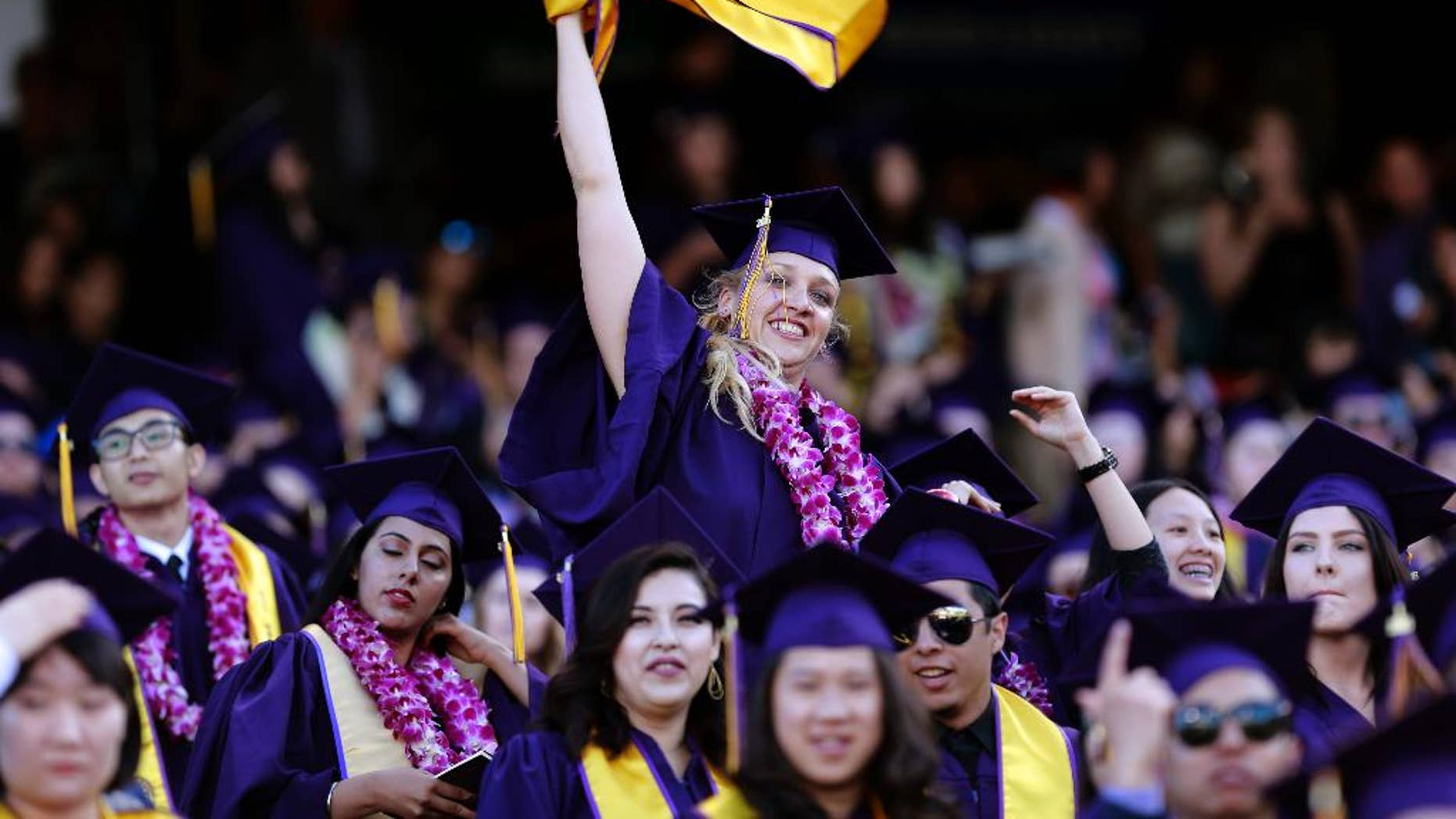 In this photo taken Friday, May 27, 2016, Jillian Sobol show her excitement during her college graduation ceremony at AT&T Park in San Francisco. More than 30 years after she was abandoned as a newborn in a dorm at San Francisco State University, Sobol has graduated from the school where she began her life. Sobol, 31, graduated with a bachelor's degree. She was left by a 19-year-old sophomore, who had concealed her pregnancy, in a box in the dorm laundry room on Nov. 5, 1984. (Michael Macor/San Francisco Chronicle via AP)