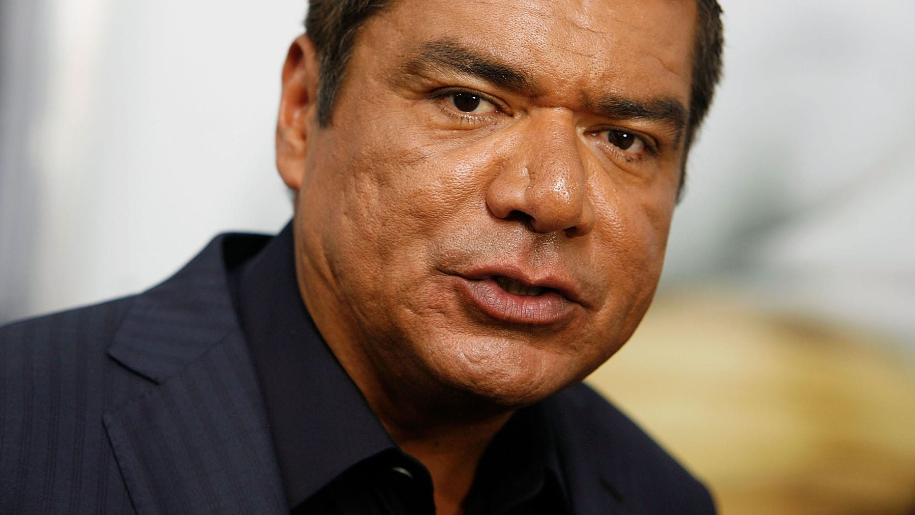 """July 24, 2011: George Lopez attends the premiere of """"The Smurfs"""" at the Ziegfeld Theater in New York City."""