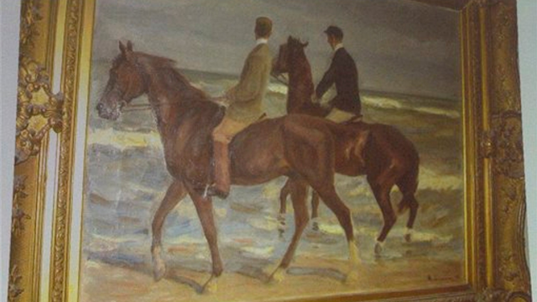 """Nov.5, 2013: A painting from Max Liebermann """"Zwei Reiter am Strande"""" (""""Two riders on the beach"""") is projected on a screen during a news conference in Augsburg, southern Germany, on the art found in Munich."""