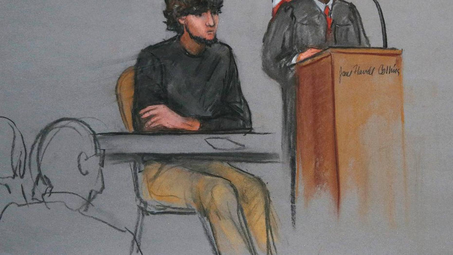 In this courtroom sketch, Boston Marathon bombing suspect Dzhokhar Tsarnaev, left, is depicted beside U.S. District Judge George O'Toole Jr., right, as O'Toole addresses a pool of potential jurors in a jury assembly room at the federal courthouse Monday, Jan. 5, 2015, in Boston. Tsarnaev is charged with the April 2013 attack that killed three people and injured more than 260. His trial is scheduled to begin on Jan. 26, 2015. He could face the death penalty if convicted.  (AP Photo/Jane Flavell Collins)