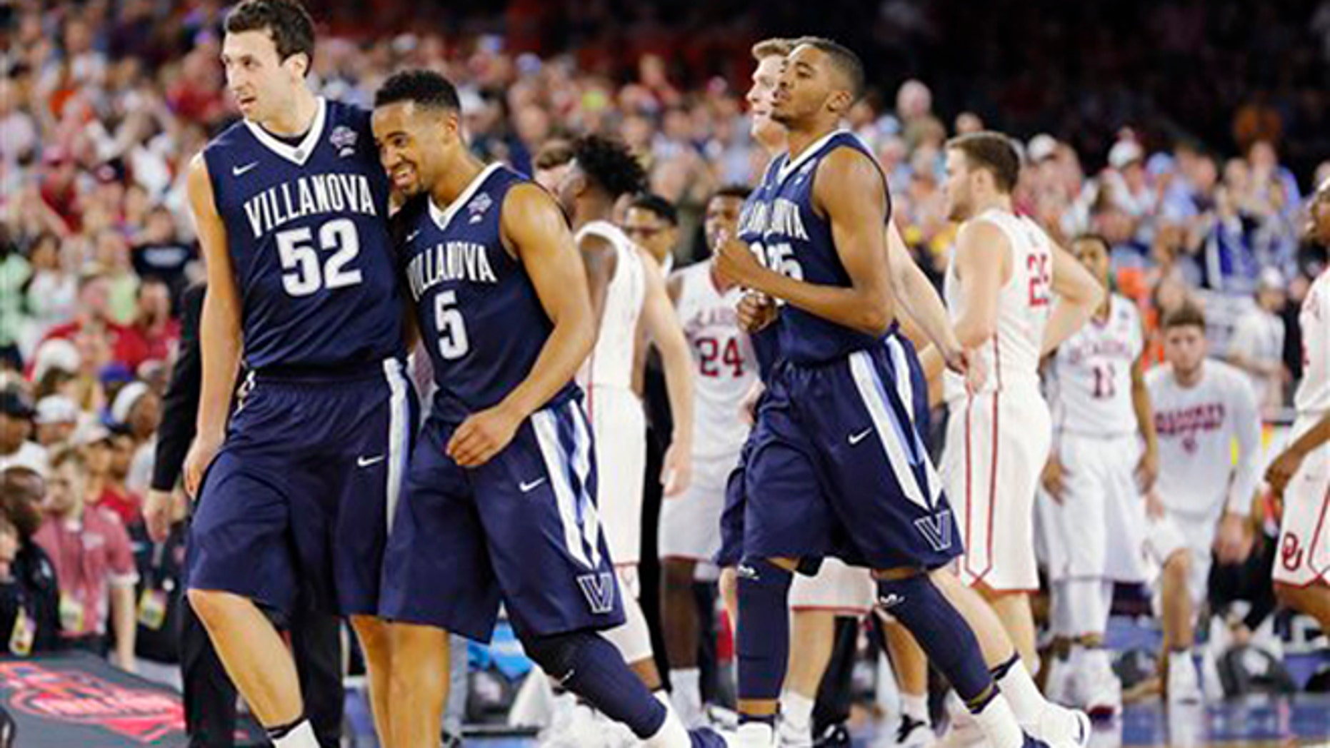 Villanova players including Phil Booth (5) and  Kevin Rafferty (52) walks off the court after an NCAA Final Four tournament college basketball semifinal game against Oklahoma Saturday, April 2, 2016, in Houston. Villanova won 95-51.(AP Photo/Kiichiro Sato)