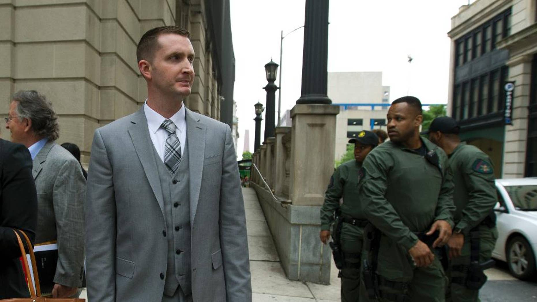Officer Edward M. Nero one of six Baltimore city police officers charged in connection to the death of Freddie Gray, walks outside of the courthouse on a lunch break during the beginning of his trial, Thursday, May 12, 2016, in Baltimore.  (AP Photo/Jose Luis Magana)