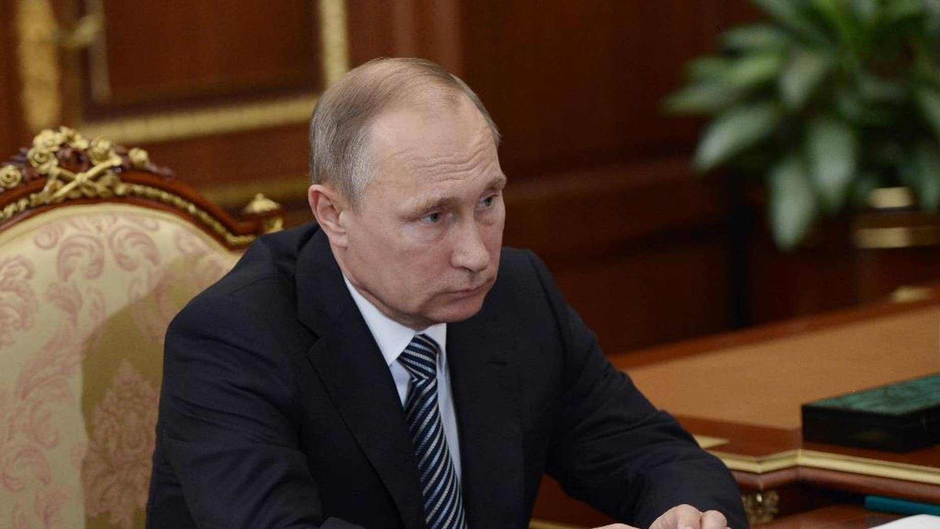 Russian President Vladimir Putin listens during a meeting with VTB CEP Andrei Kostin in Moscow's Kremlin on Tuesday, Sept. 27, 2016. The meeting focused on the current operations of the state-controlled VTB, Russia's second-largest bank. (Alexei Nikolsky/Sputnik, Kremlin Pool Photo via AP)