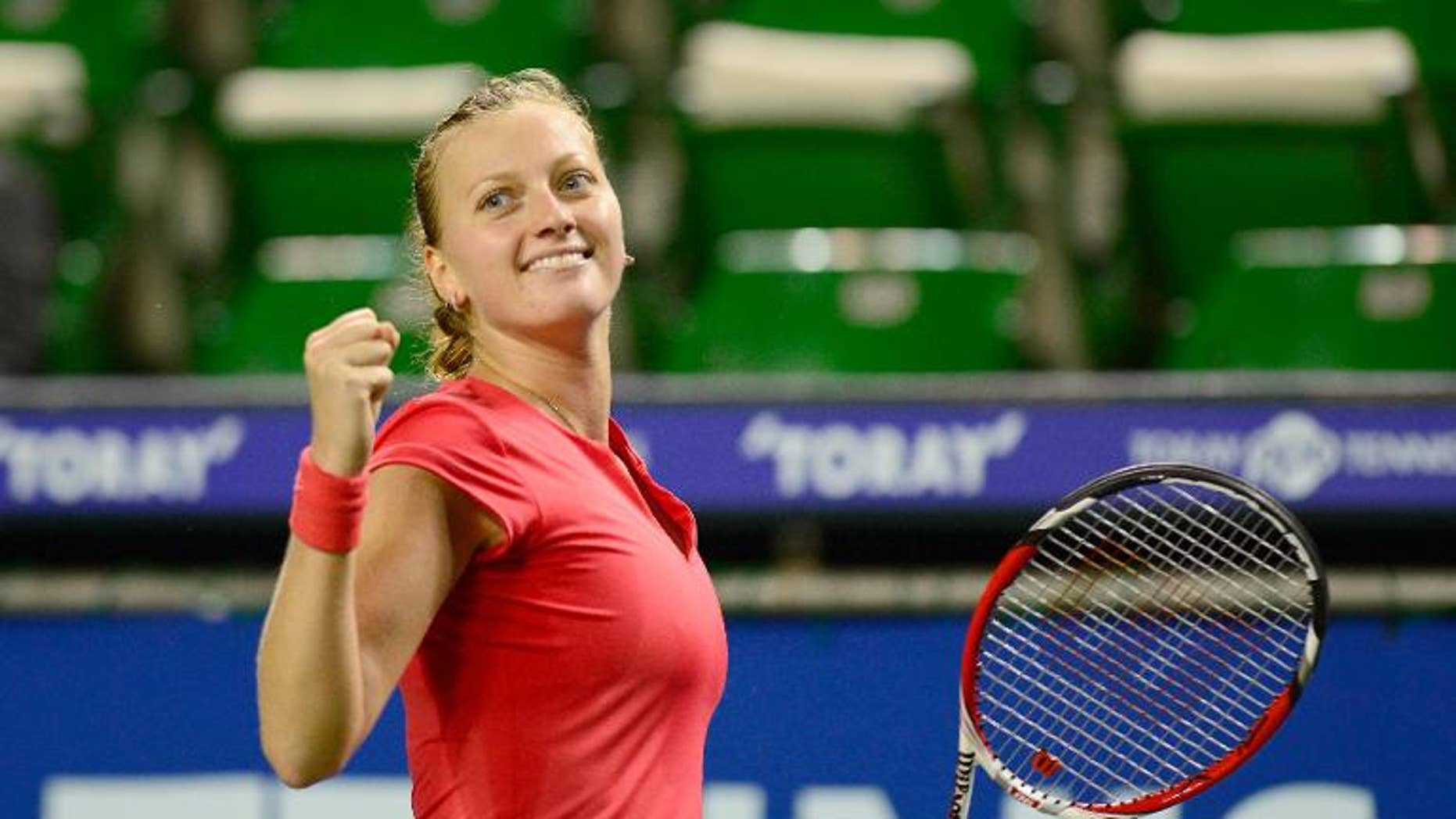 Petra Kvitova of the Czech Republic reacts after her semi-final victory against Venus Williams in Tokyo on September 27, 2013