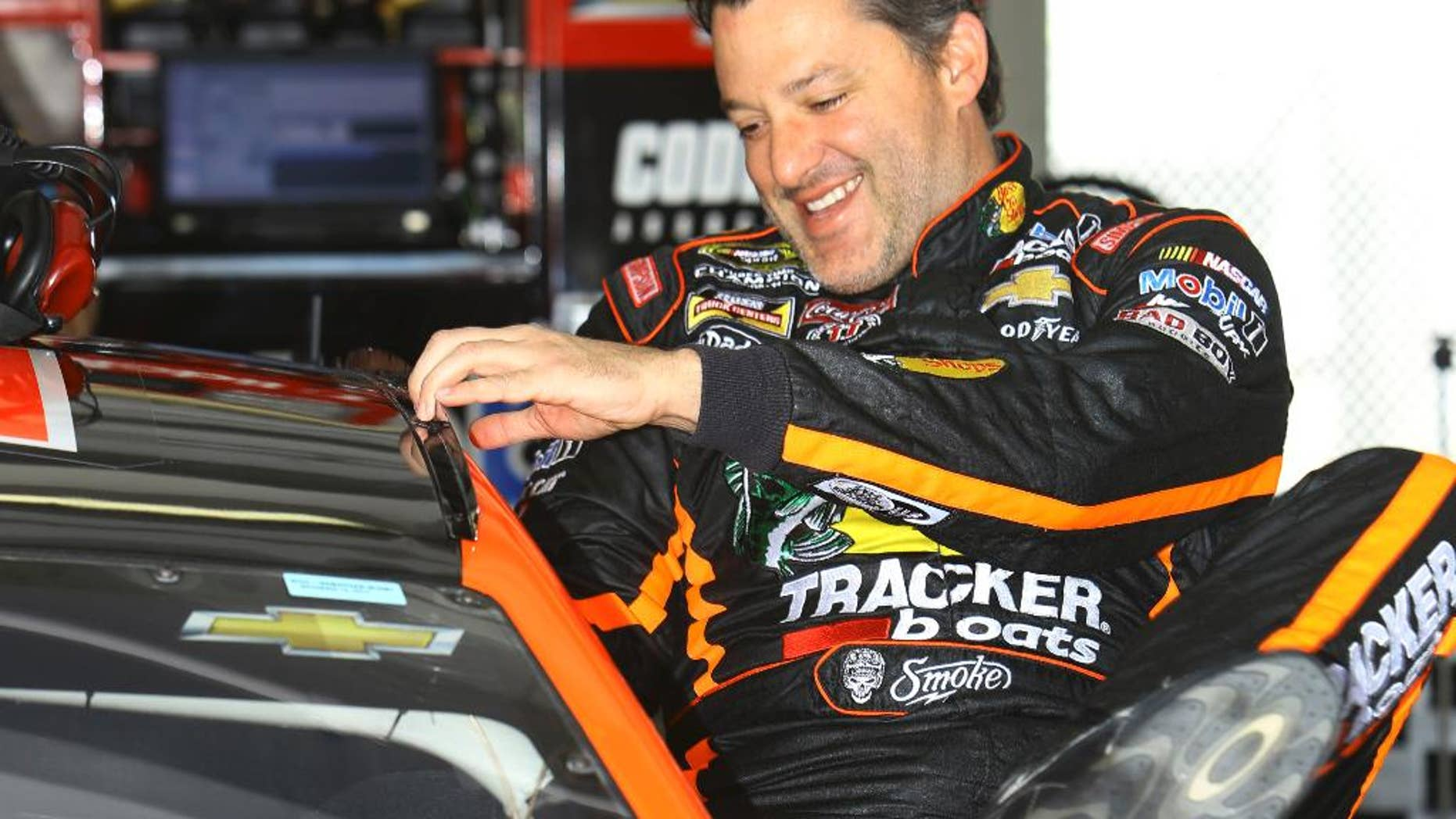 NASCAR driver Tony Stewart gets in his car before practice at Homestead-Miami Speedway, Friday, Nov. 14, 2014, in Homestead, Fla. (AP Photo/David Graham)