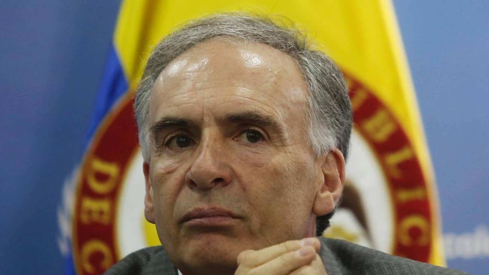 FILE - In this Monday, Oct. 10, 2016, file photo, Jean Arnault, of France, the head of the U.N. political mission inColombia, attends a press conference in Bogota, Colombia. Colombians don't want the peace process to unravel and would like to see quick agreement on a new peace deal to replace the one rejected by voters, Arnault said Wednesday, Oct. 19. (AP Photo/Ivan Valencia, File)