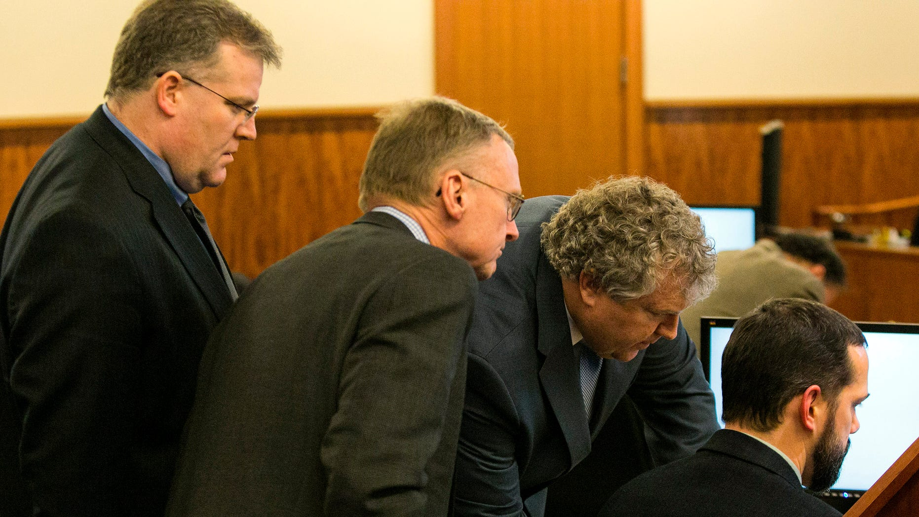 Prosecution and defense teams during the murder trial for Aaron Hernandez in Fall River, Mass., Feb. 20, 2015.