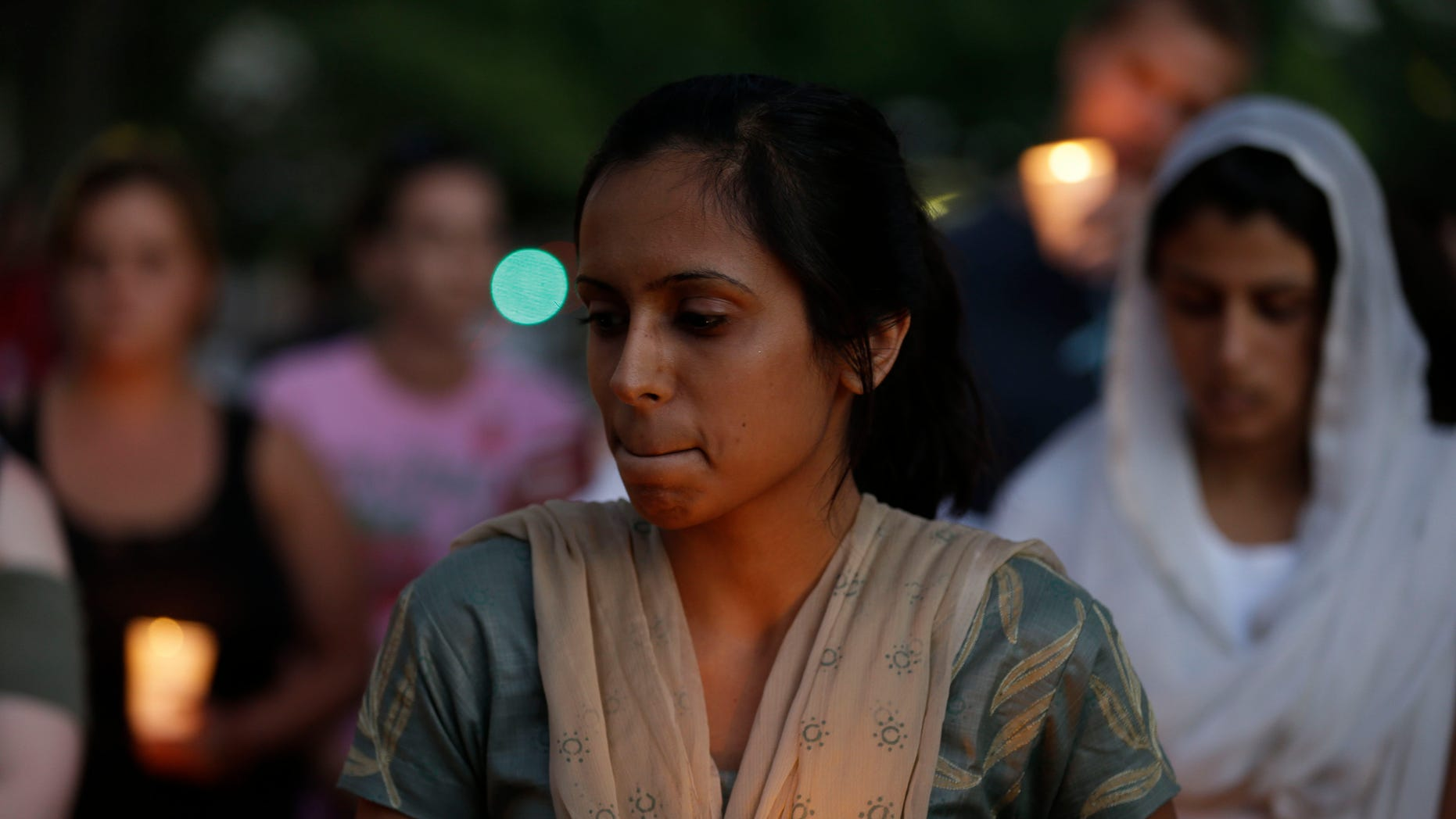 Aug 5, 2012: Mourners take part in a candle light vigil for the victims of the Sikh Temple of Wisconsin shooting, in Milwaukee.