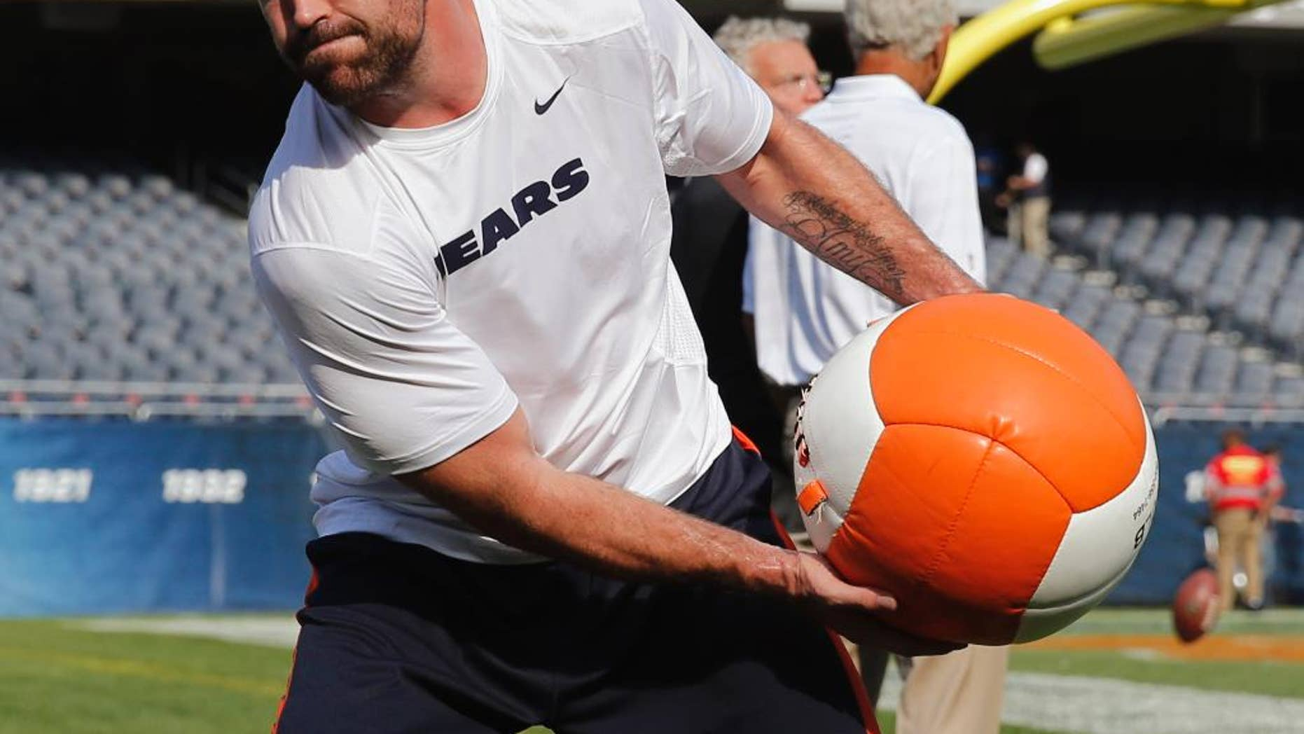 Chicago Bears defensive end Jared Allen warms up before an NFL preseason football game against the Philadelphia Eagles Friday, Aug. 8, 2014, in Chicago. (AP Photo/Charles Rex Arbogast)