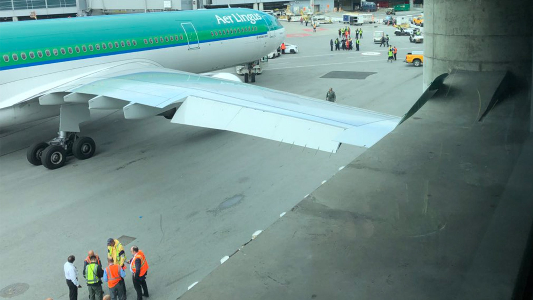 An airport worker at SFO towed an Aer Lingus plane into a concrete pole, resulting in damage to the wing.