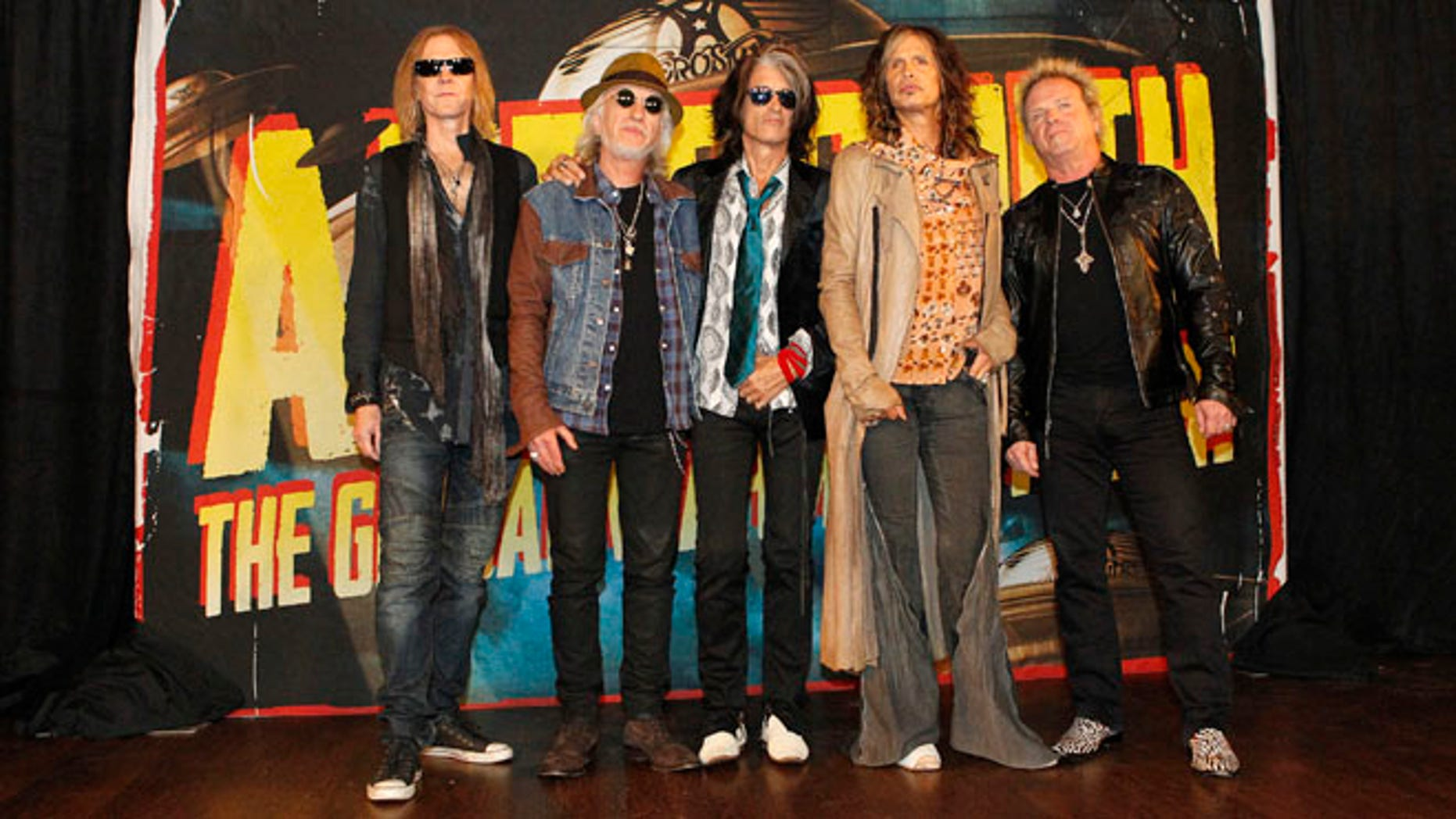 """September 12, 2012. Rock band Aerosmith (L-R) Tom Hamilton, Brad Whitford, Joe Perry, Steven Tyler and Joey Kramer pose while promoting their upcoming album """"Music from Another Dimension!"""" in West Hollywood."""