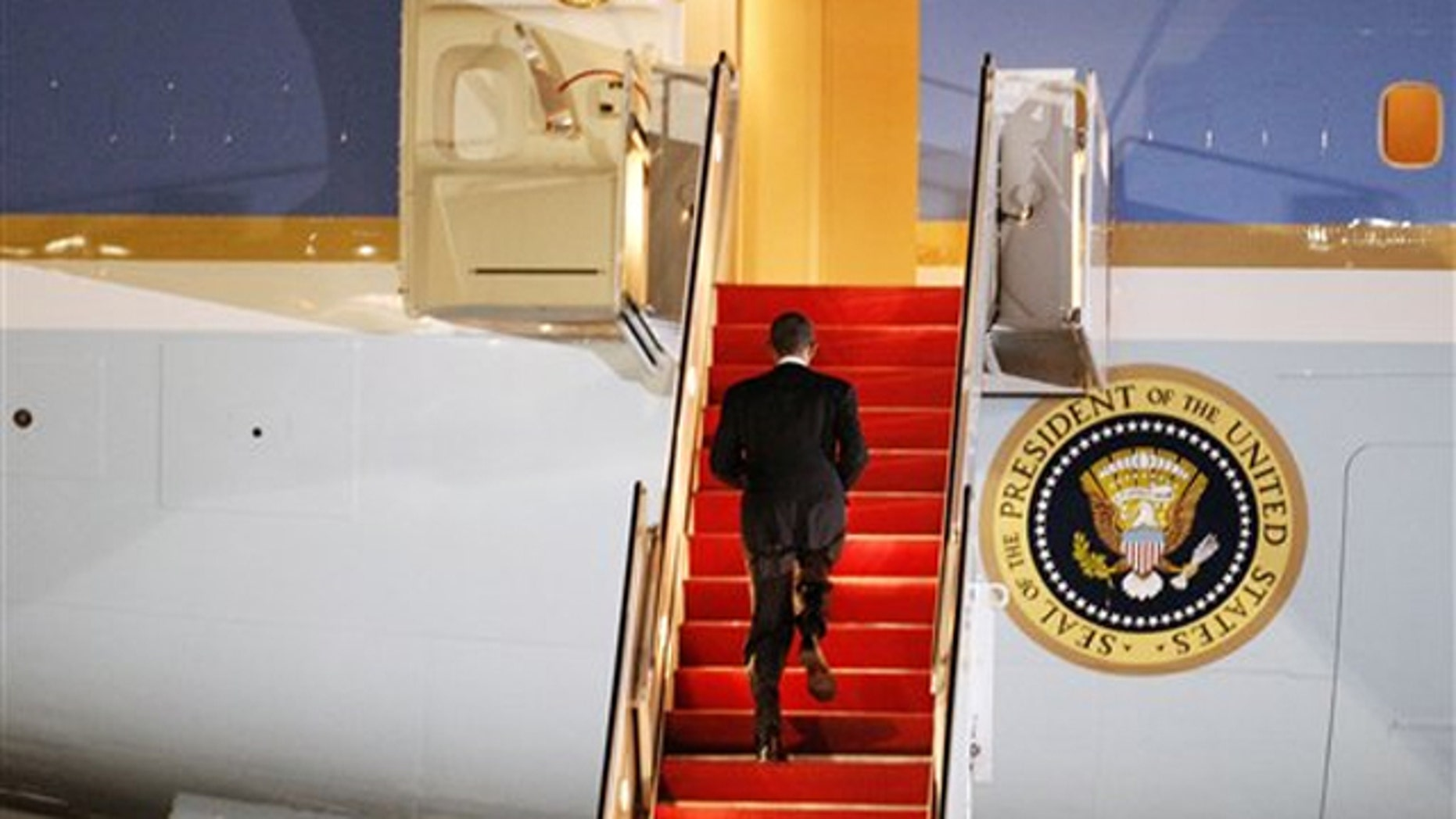 President Obama walks up the stairs of Air Force One before leaving for Lisbon, Portugal, at Andrews Air Force Base on Nov. 18. (AP Photo)