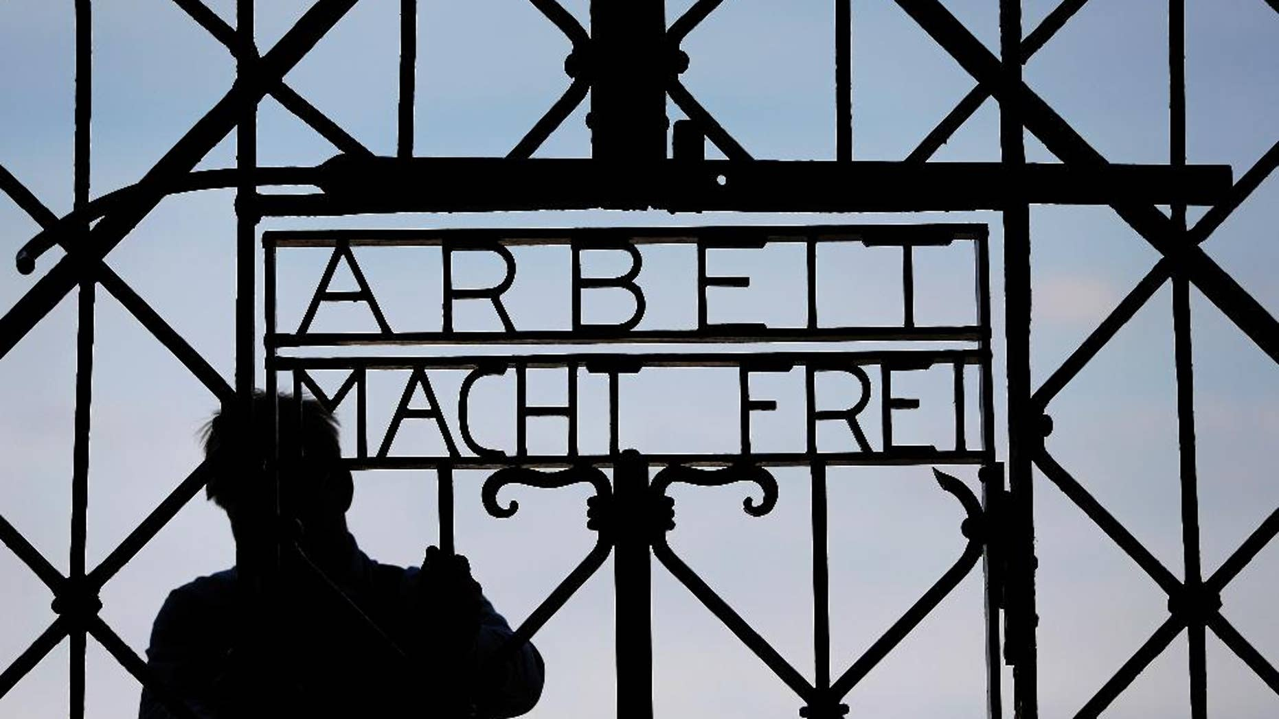 """FILE In this April 29, 2015 file picture a  blacksmith prepares a replica of the Dachau Nazi concentration camp gate, with the writing """"Arbeit macht frei"""" (Work Sets you Free) at the main entrance of the memorial in Dachau, Germany,. German police say Friday Dec. 2, 2016 the wrought-iron gate to the Nazis' Dachau concentration camp that was stolen two years ago appears to have been found in western Norway.  (AP Photo/Matthias Schrader,File)"""