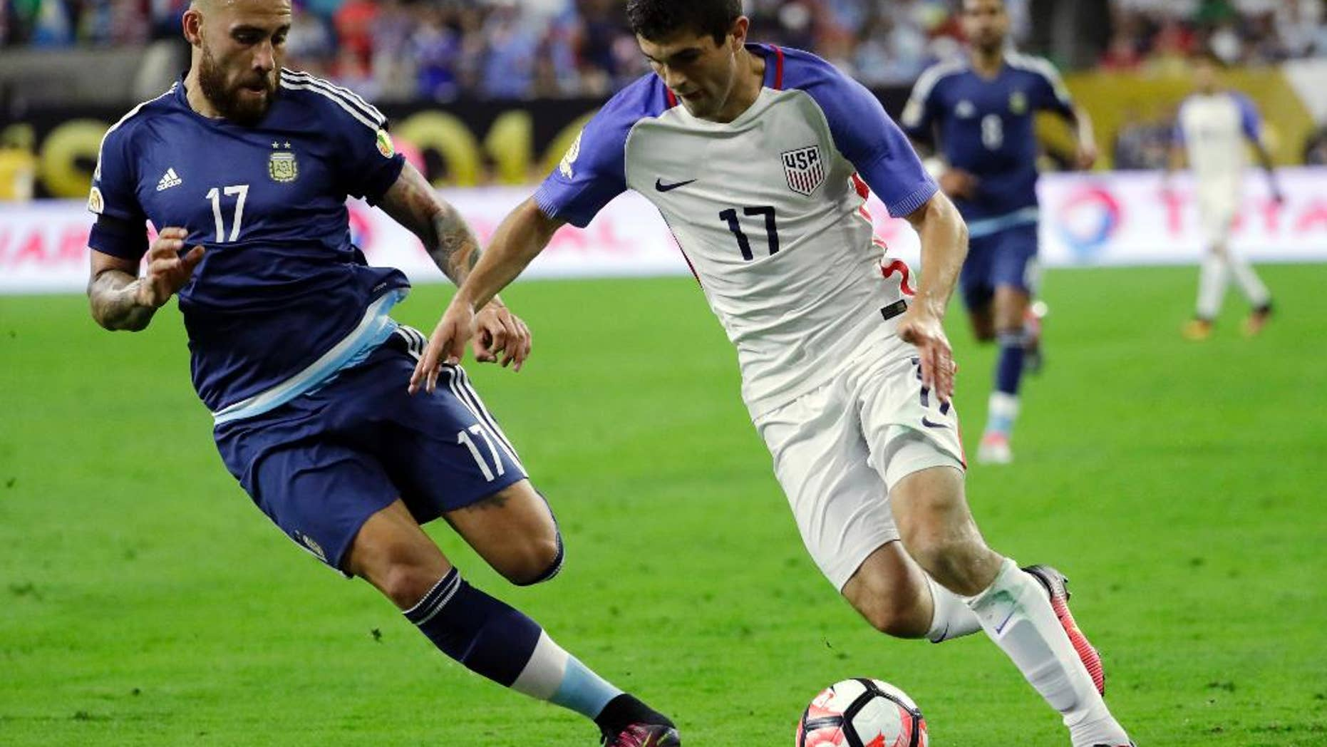 FILE - In this June 21, 2016, file photo, Argentina's Nicolas Otamendi, left, works against United States' Christian Pulisic during a Copa America Centenario semifinal soccer match  in Houston. Coach Jurgen Klinsmann made it clear Monday, Sept. 5, he intends to bring the talented teenager Pulisic along slowly and is not likely to start him Tuesday against Trinidad and Tobago, the Americans' finale in the semifinal round of the North and Central American and Caribbean region. (AP Photo/David J. Phillip, File)