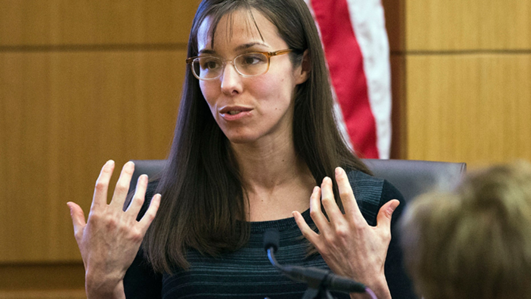 This March 5, 2013 photo shows Jodi Arias gesturing toward the jury, in Maricopa County Superior Court in Phoenix.