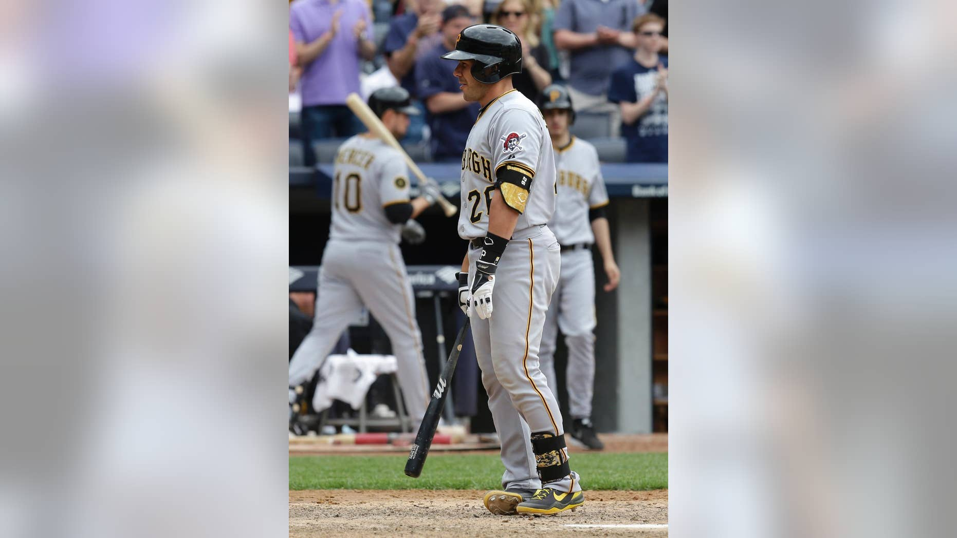 Pittsburgh Pirates' Tony Sanchez reacts after striking out to end the first game of a double-header against the New York Yankees at Yankee Stadium, Sunday, May 18, 2014 in New York. The Yankees defeated the Pirates 4-3. (AP Photo/Seth Wenig)