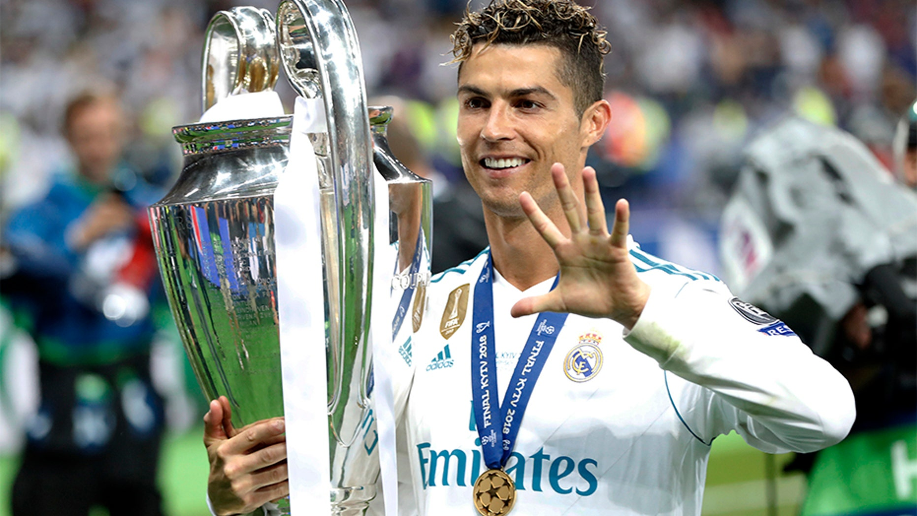 Real Madrid's Cristiano Ronaldo celebrates after winning the 2018 Champions League Final soccer match between Real Madrid and Liverpool at the Olimpiyskiy Stadium in Kiev, Ukraine.  The club announced Tuesday that he is departing Real Madrid to join Italy's Juventus.