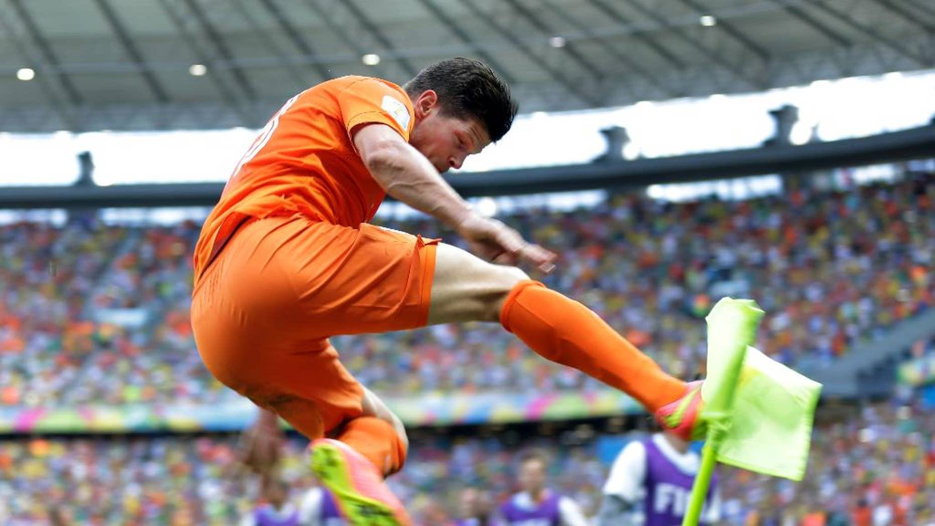 Netherlands' Klaas-Jan Huntelaar celebrates after scoring his side's second goal during the World Cup round of 16 soccer match between the Netherlands and Mexico at the Arena Castelao in Fortaleza, Brazil, Sunday, June 29, 2014.  The Netherlands won the match 2-1. (AP Photo/Natacha Pisarenko)